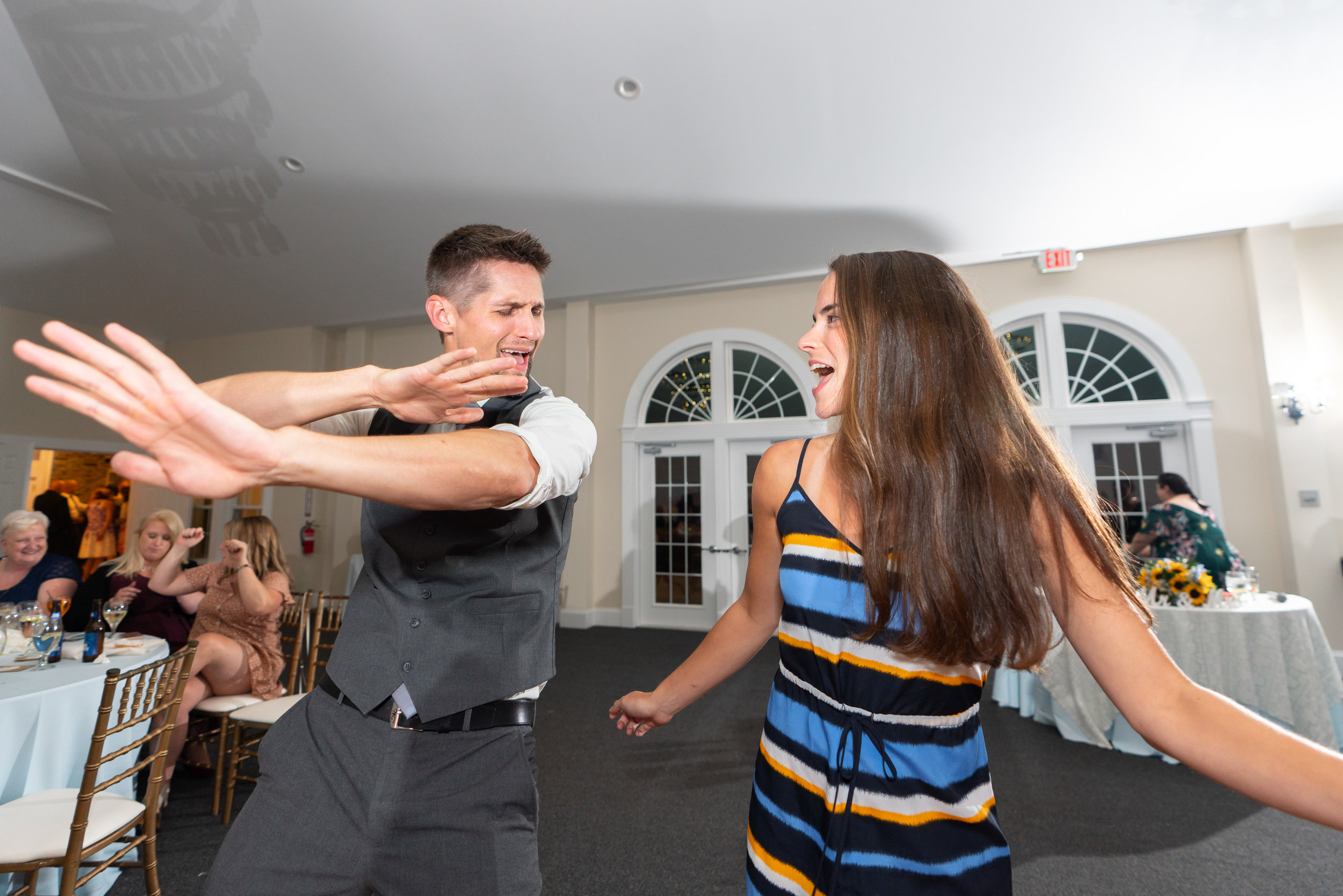 Two guests dancing with DJ Jake Sherman at stone manor