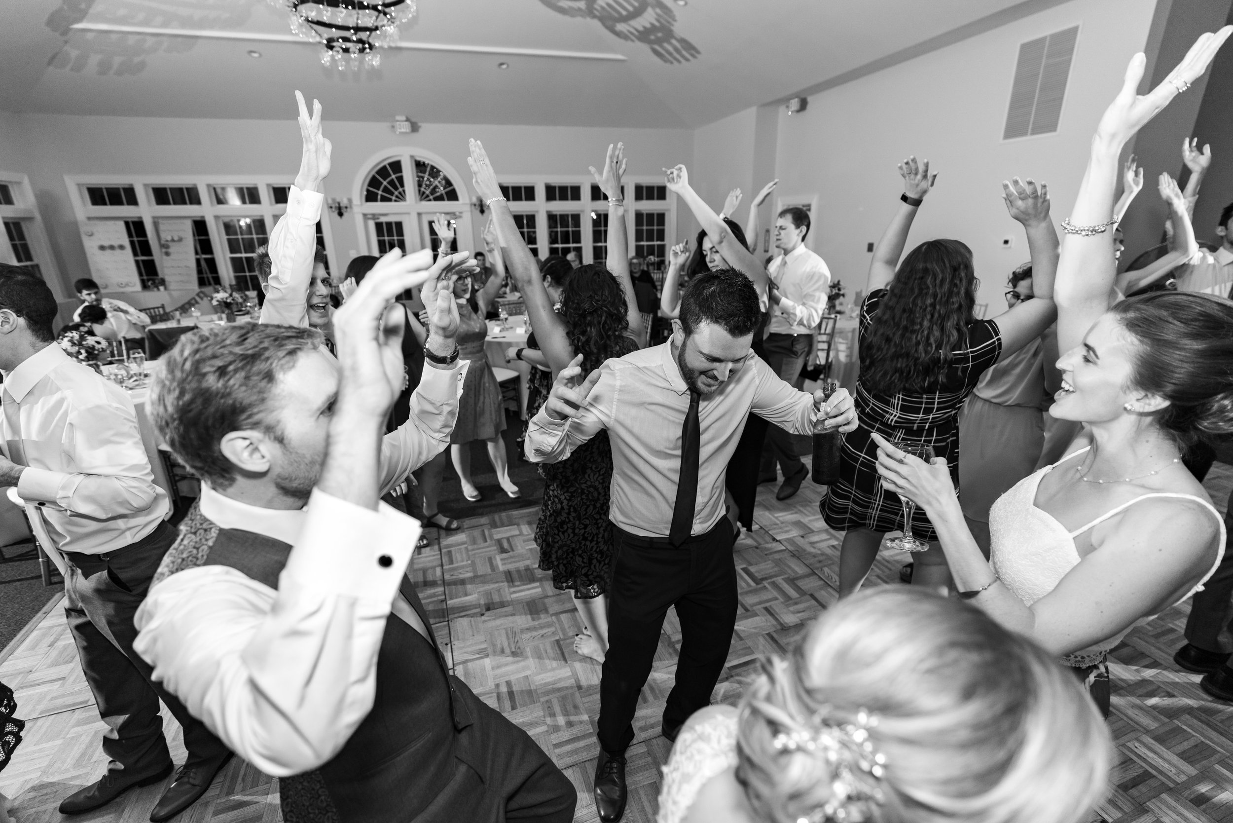 groom and friends dancing at stone manor country club