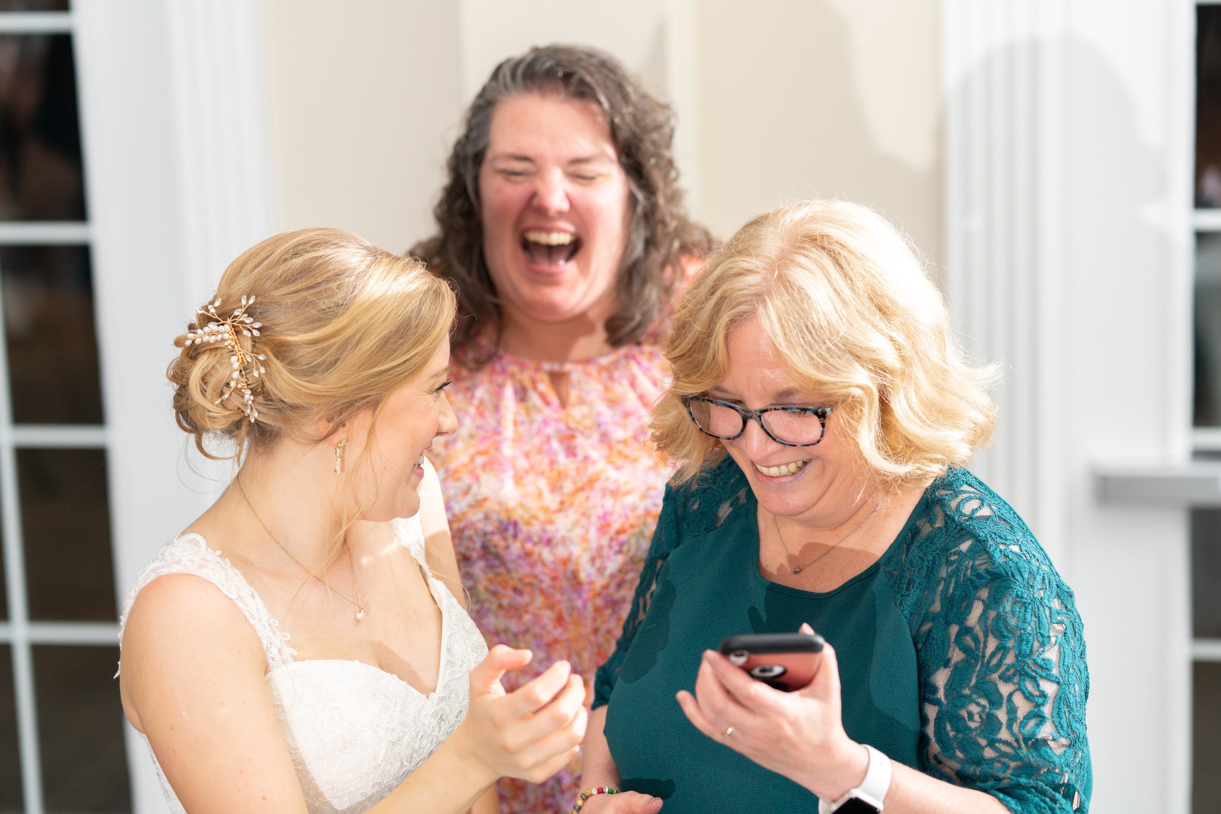 bride taking selfie with guests at stone manor country club