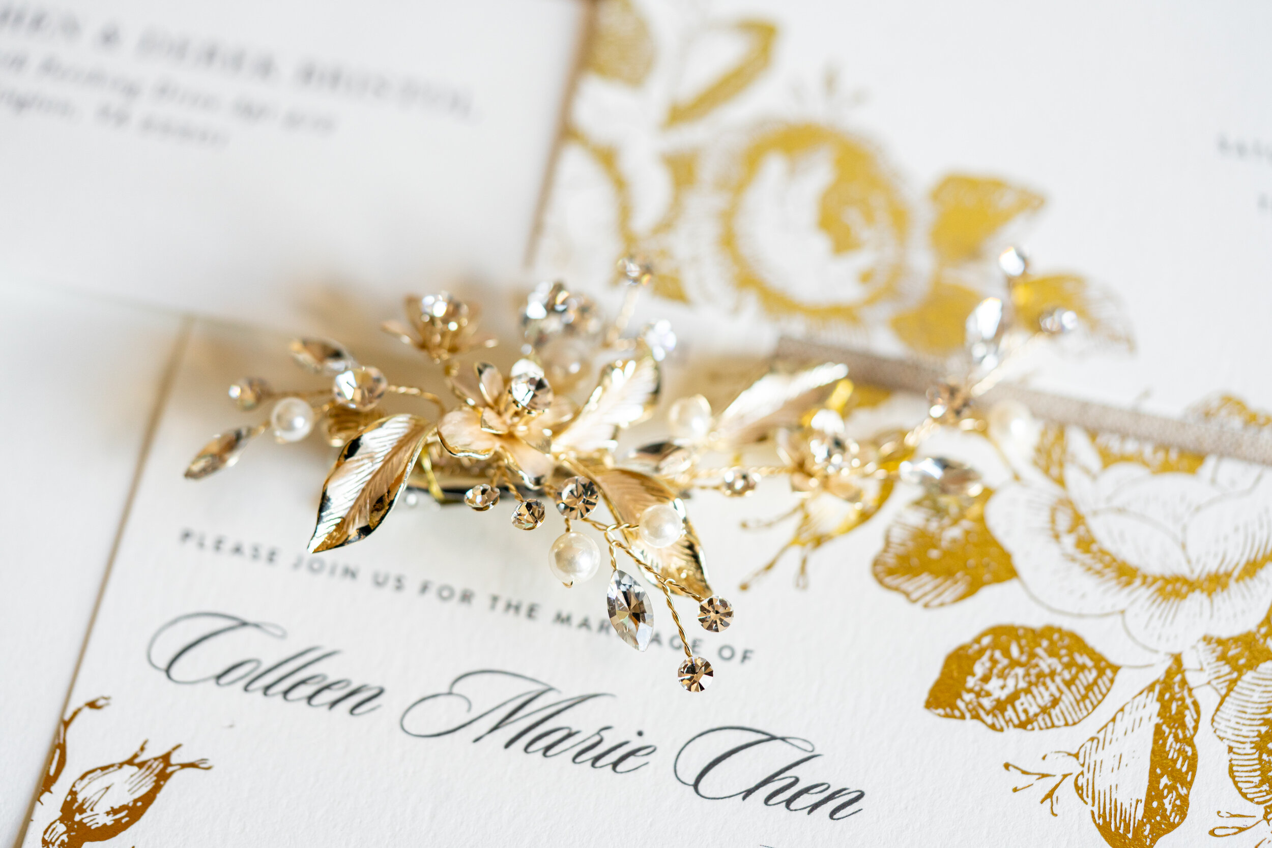 Bridal hair piece and invitations at Embassy Suites Springfield wedding