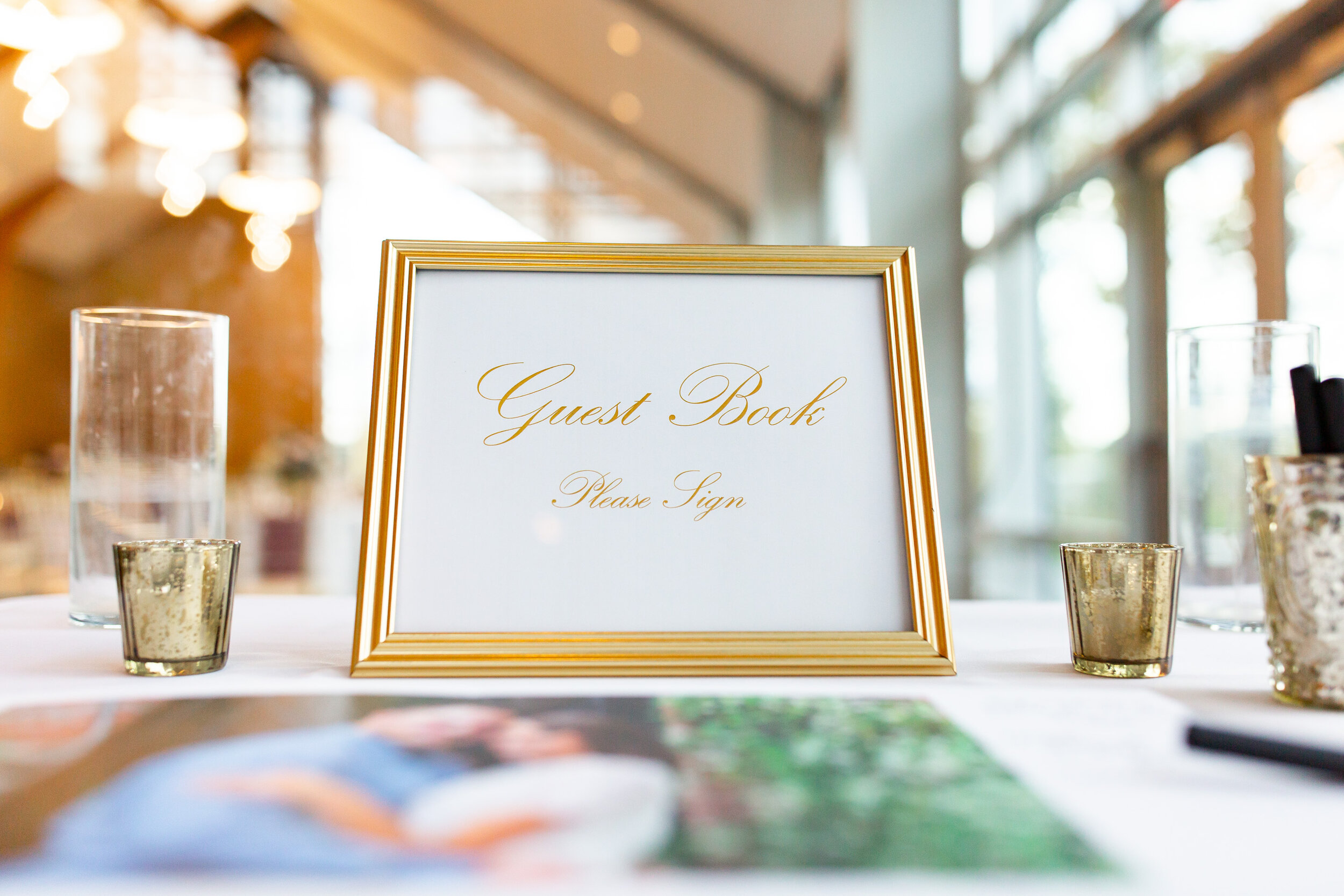 Gold guest book and sign at Riverview at Occoquan