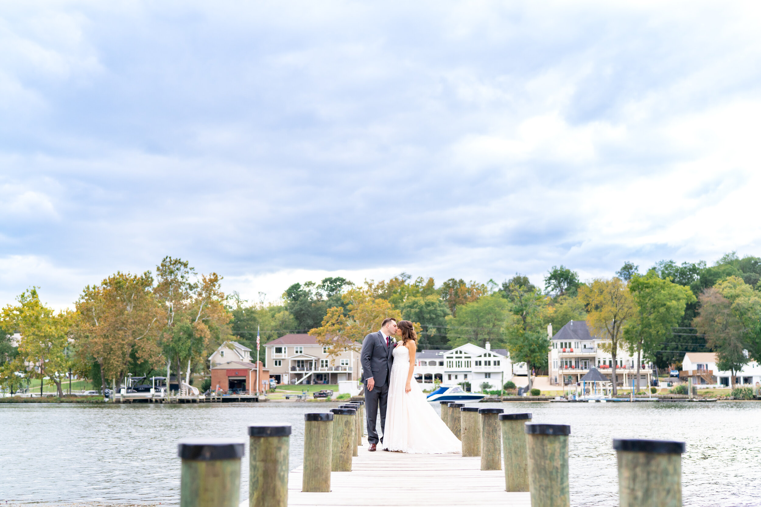 Bride and groom on the dock at Riverview at Occoquan