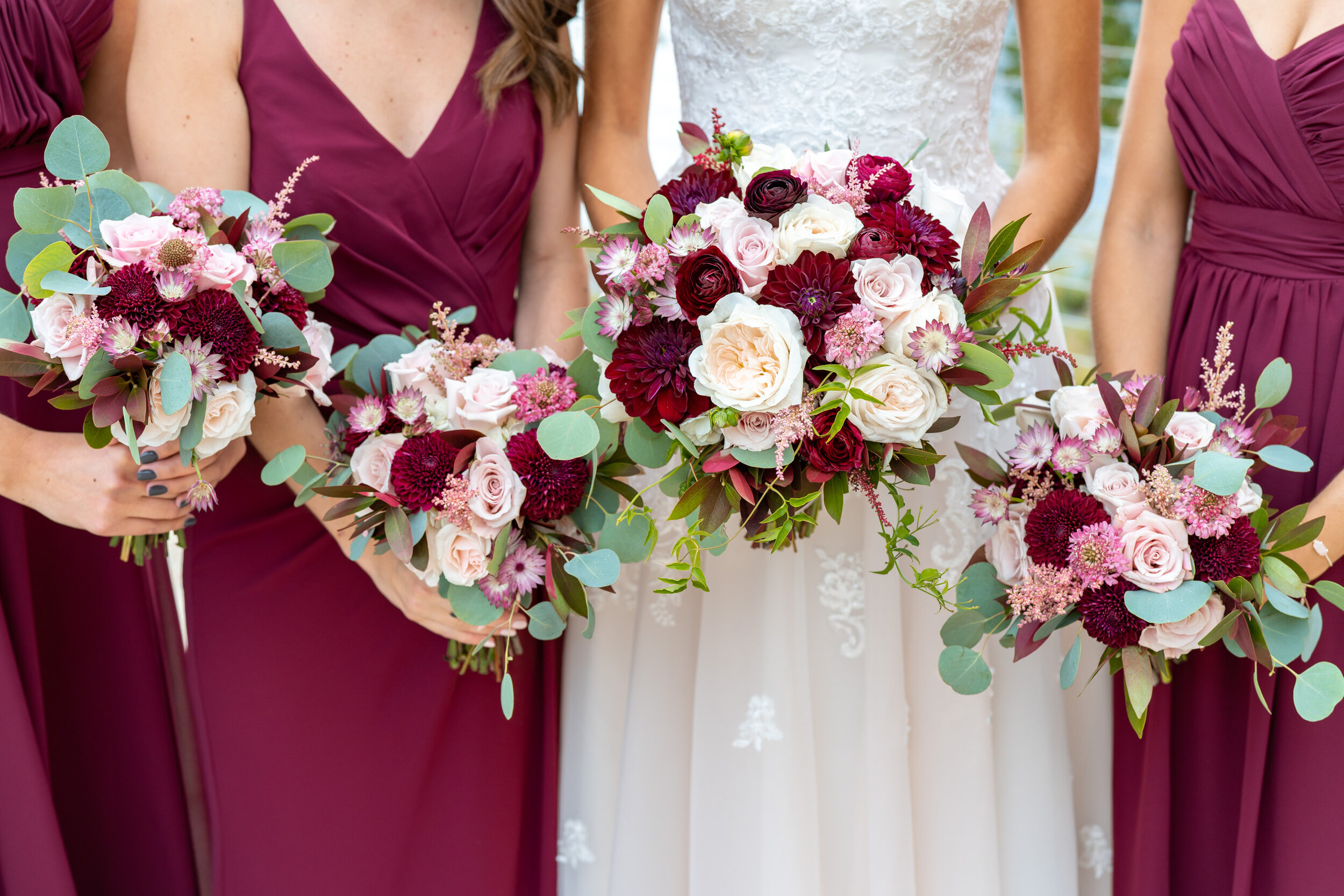 Wedding bridal party on patio at Riverview at Occoquan with Bloom Reston Florals