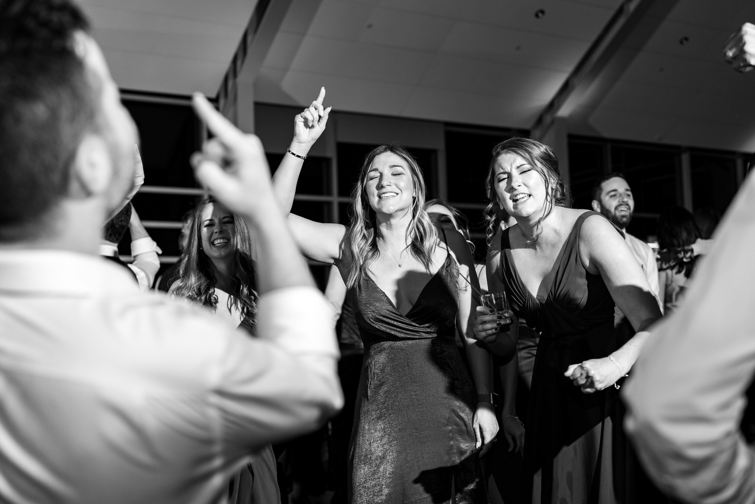 Bridesmaids and groomsmen singing and dancing on the dance floor