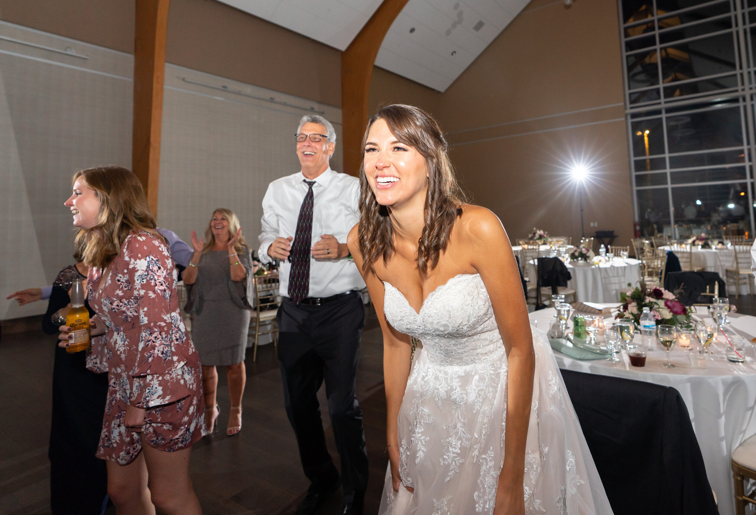 Bride watching the groom lifted in the air at Riverview Occoquan
