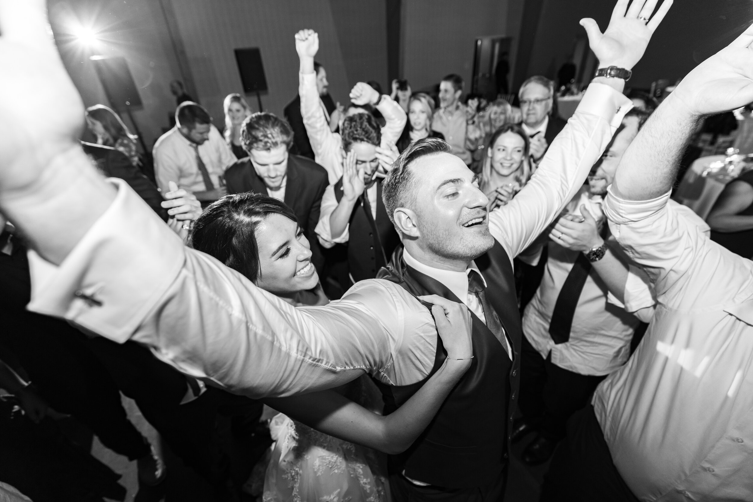 Bride clutching groom in the middle of the dance floor during last song