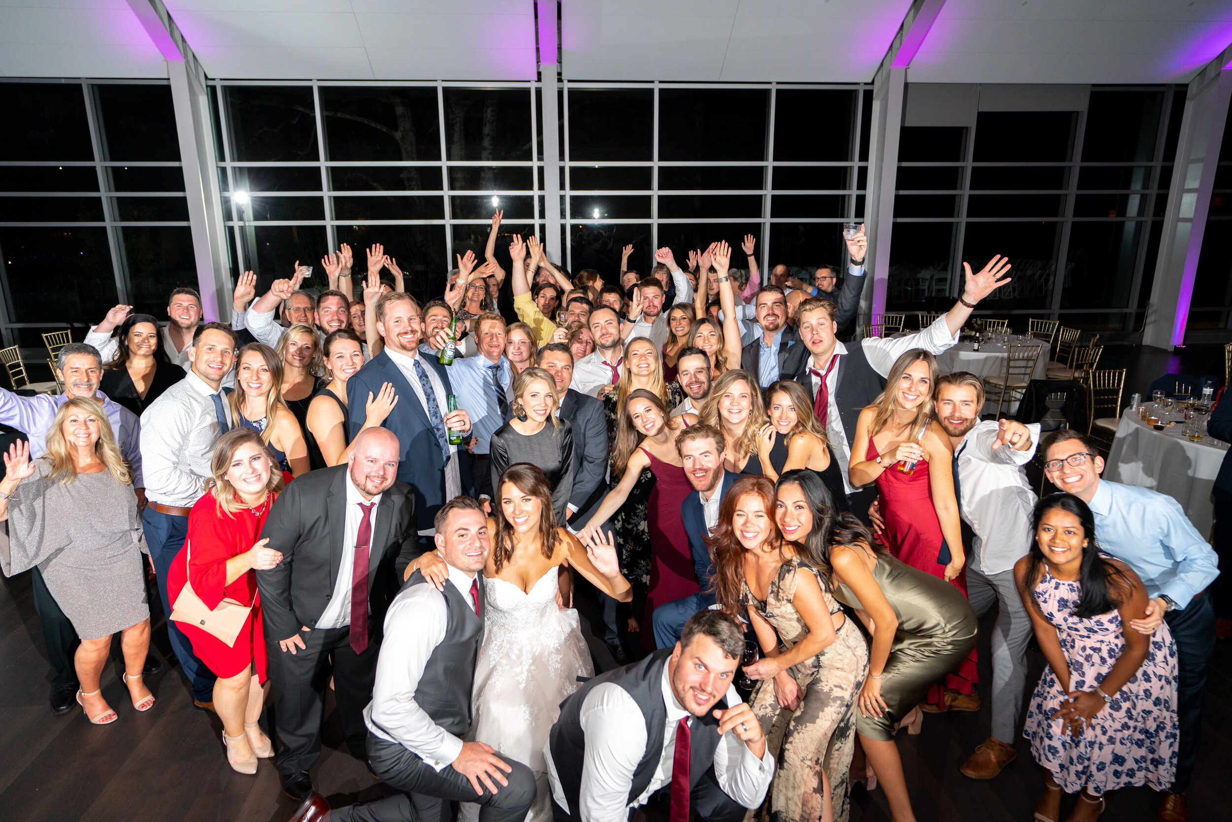 All of the guests have a group photo at the end of the night on the dance floor