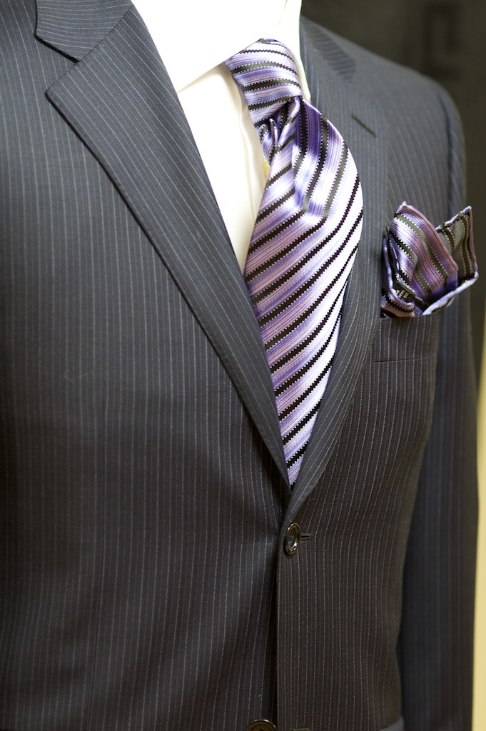 Classic two button, single breasted suit with side vents at the back.