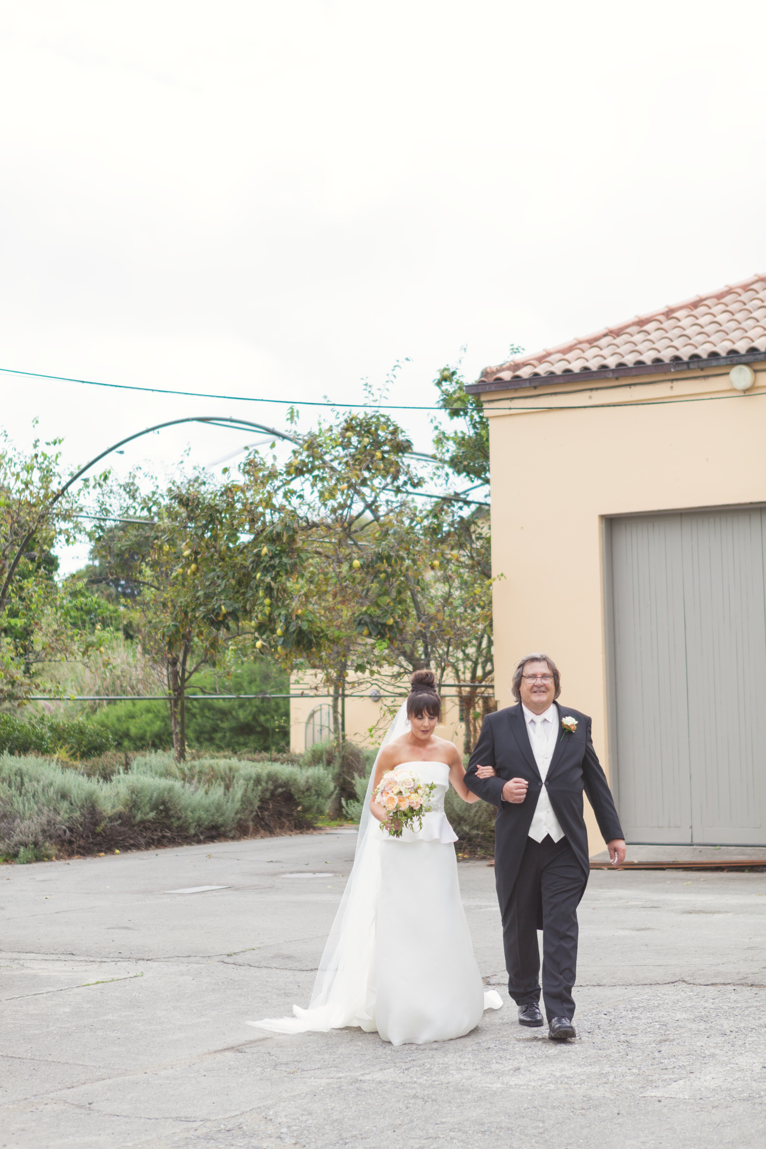 Bride walking down wedding aisle at The Milk Station