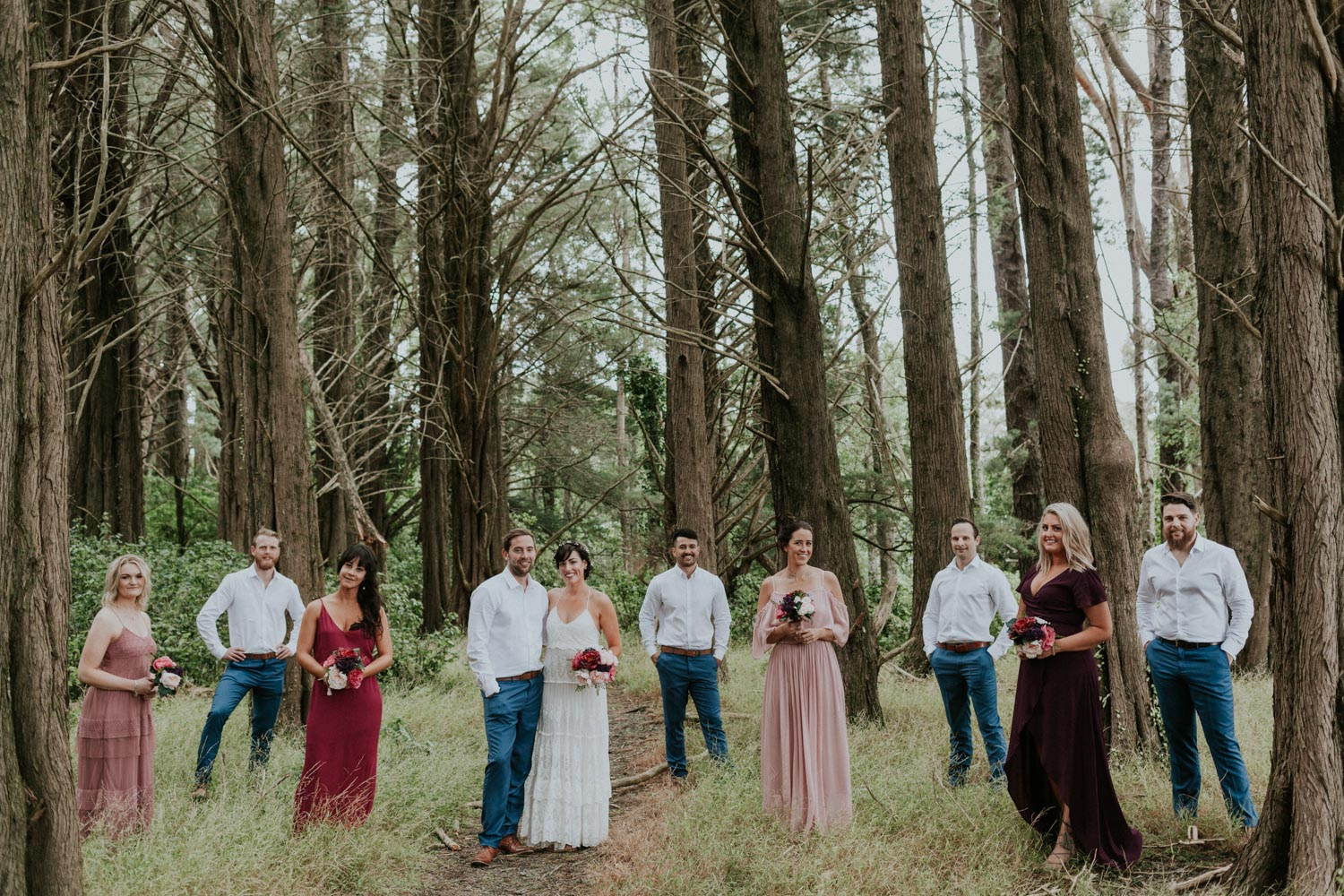 Bridal party photos in a pine forest