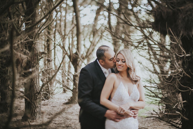 Wedding photo taken in pine tree forest