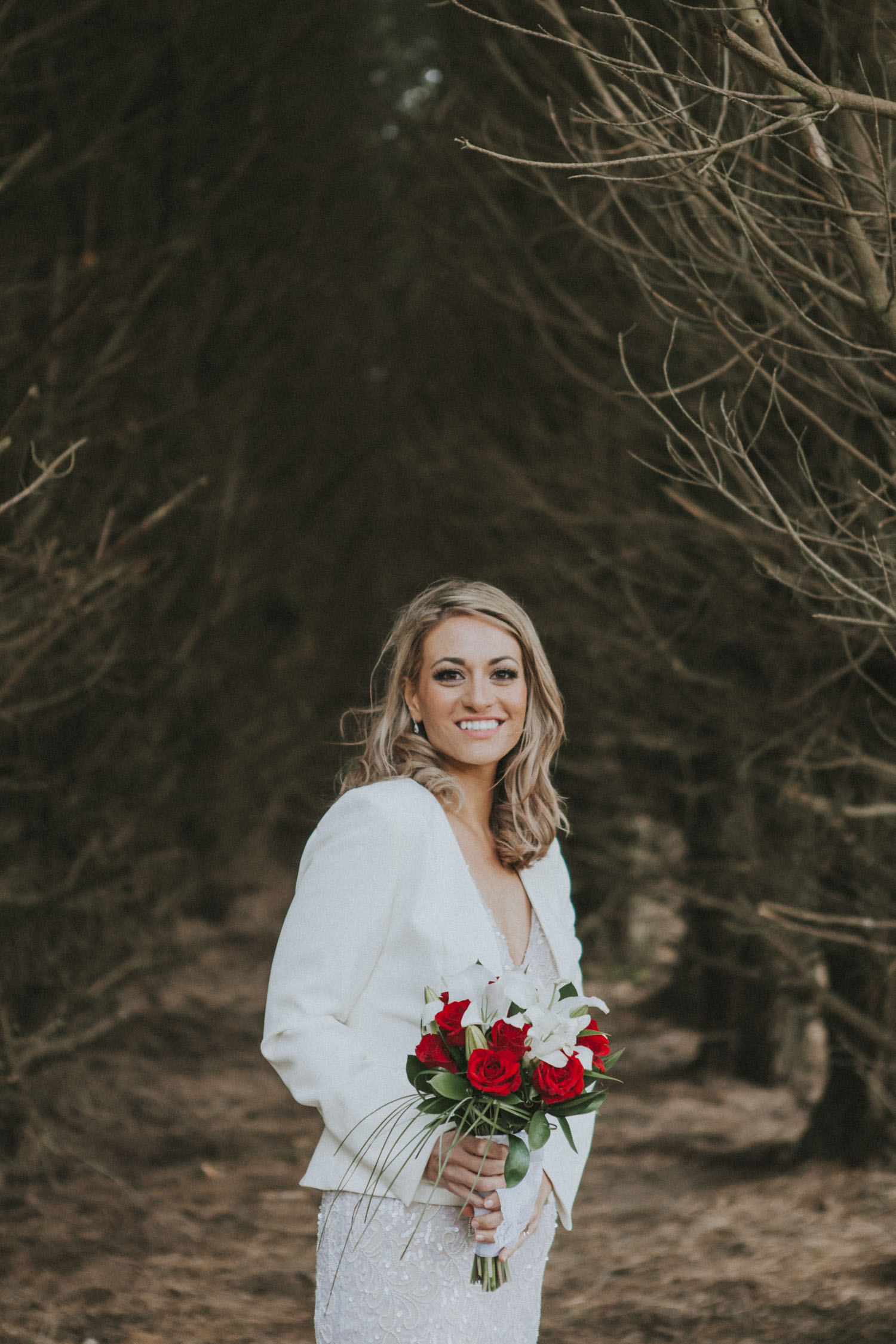 Beautiful photo of Bride standing in a pine tree forest