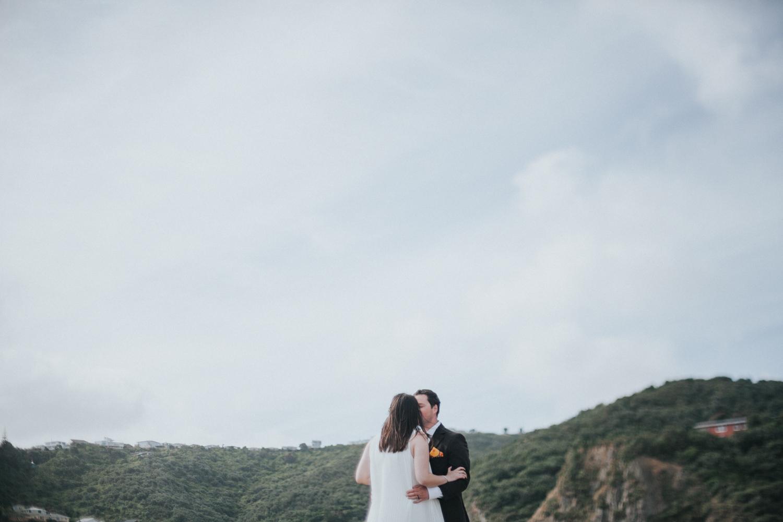 Groom kisses his Bride in wedding photo