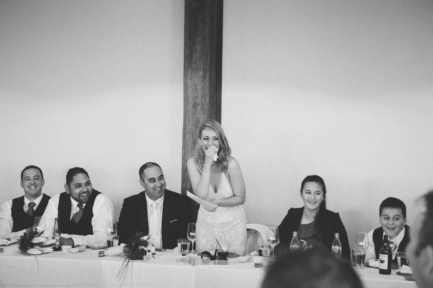 Bride laughing during reception speeches