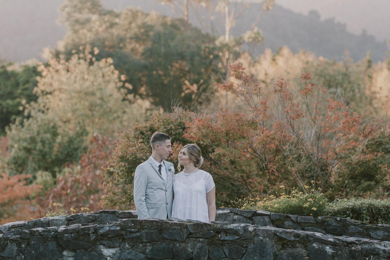 Newly weds standing on bridge