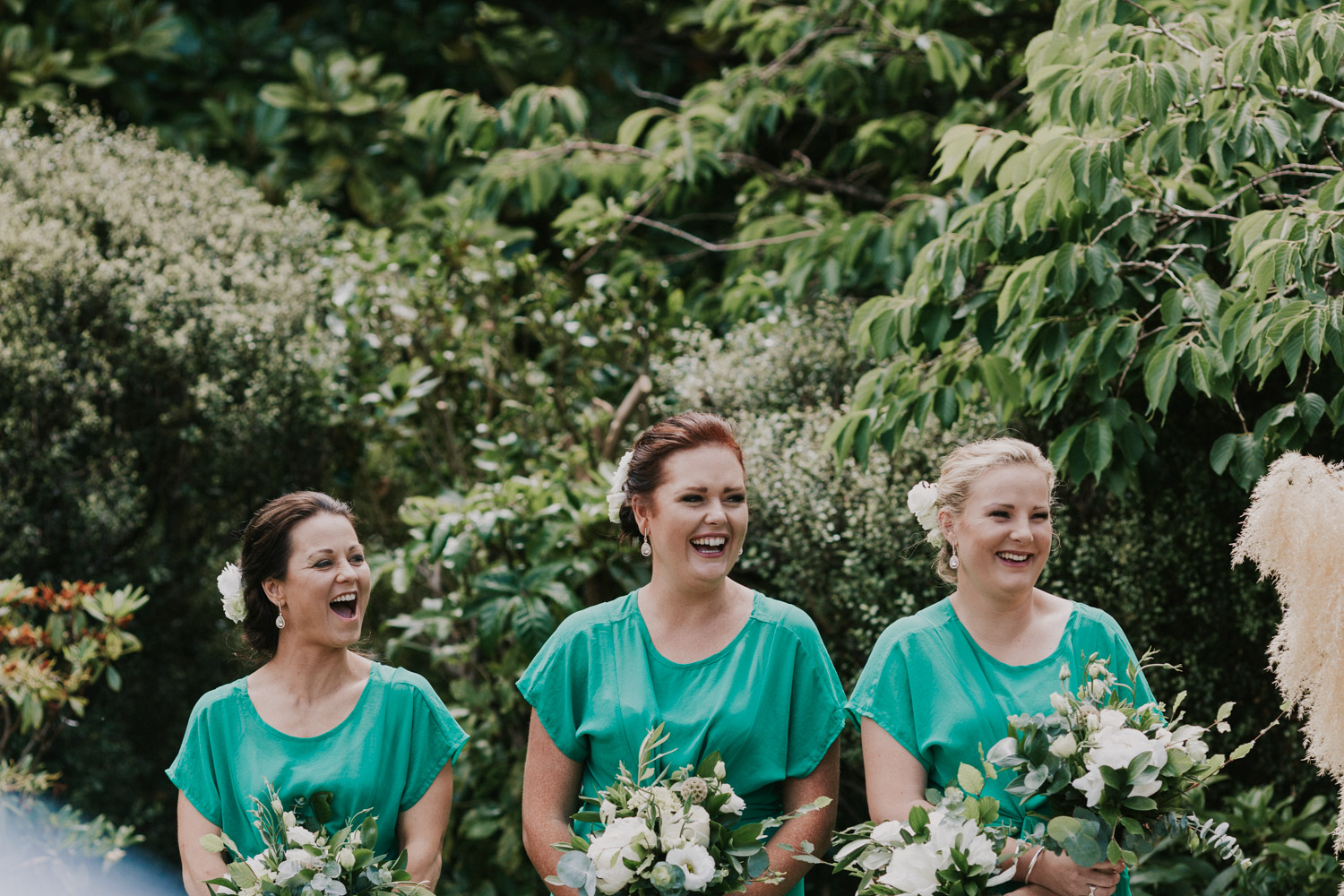 Bridesmaids laughing at wedding ceremony