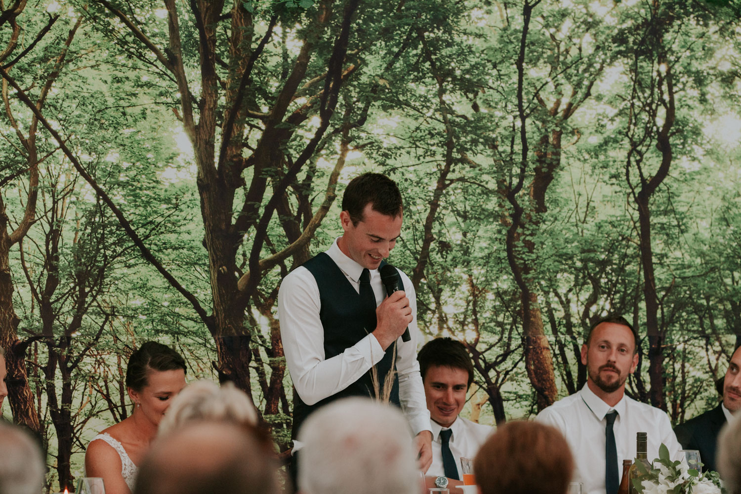 Groom speaking at his wedding