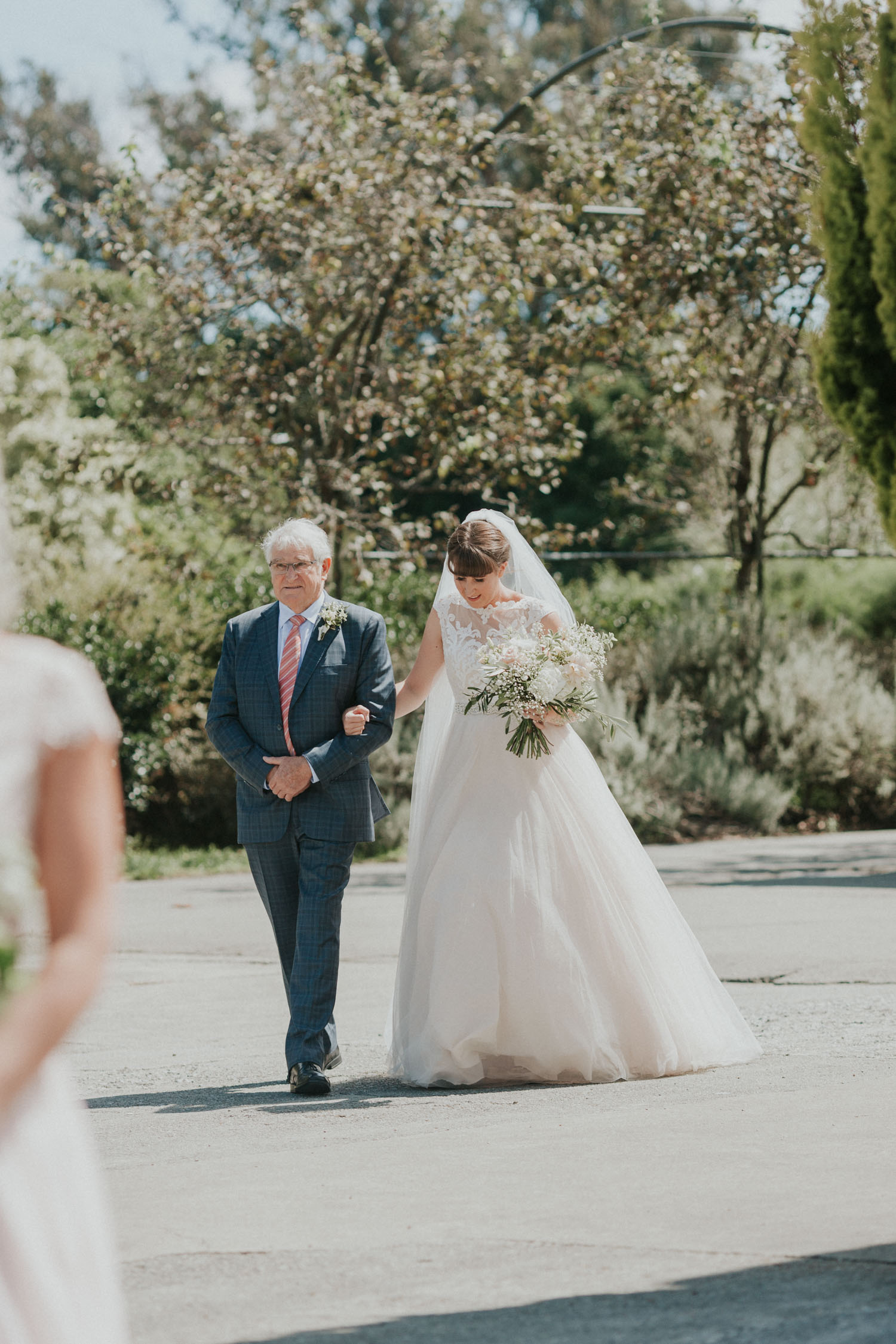 Father walking his daughter to the wedding ceremony