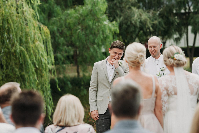 Groom looking at his bride