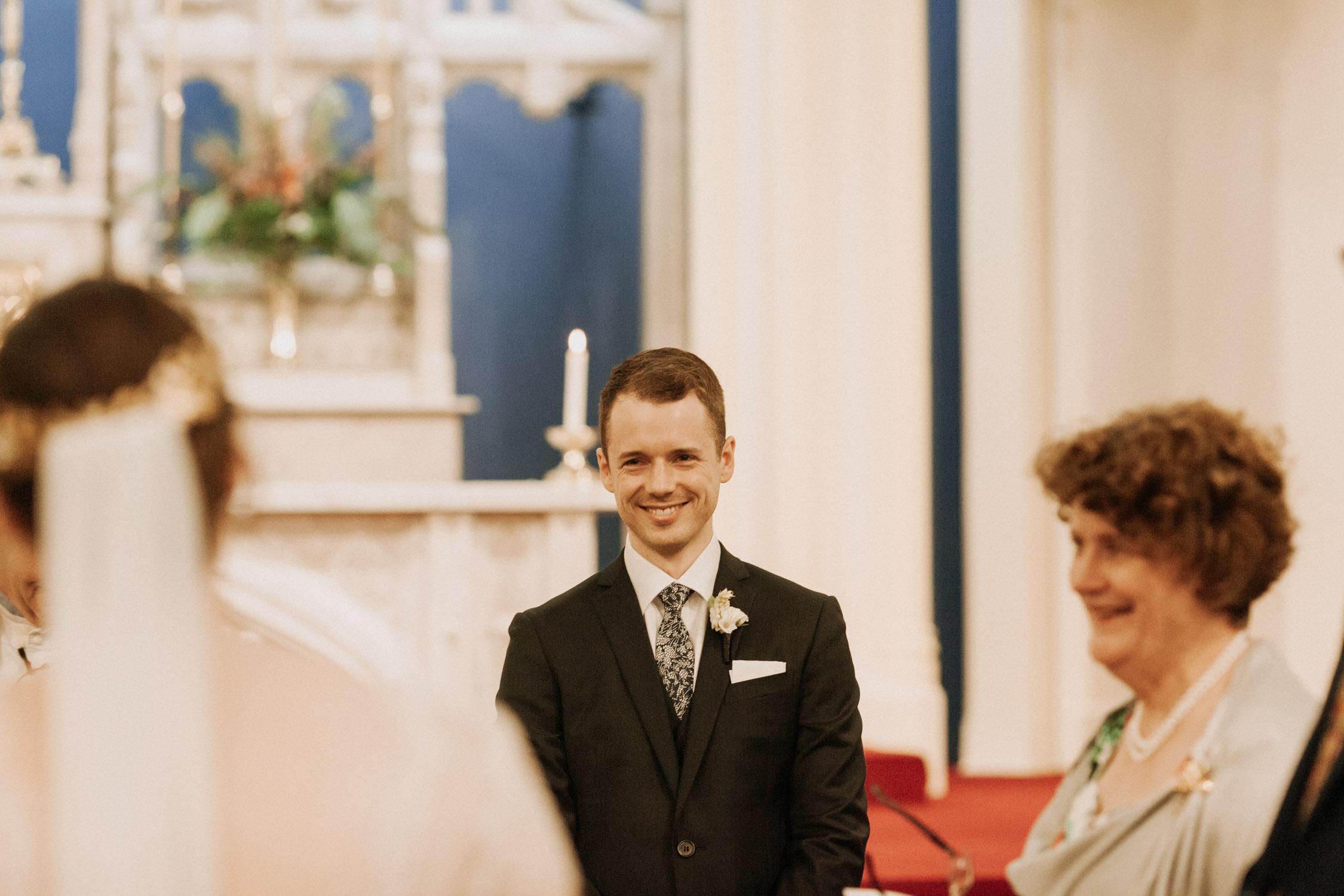 Groom seeing his bride walk down the aisle