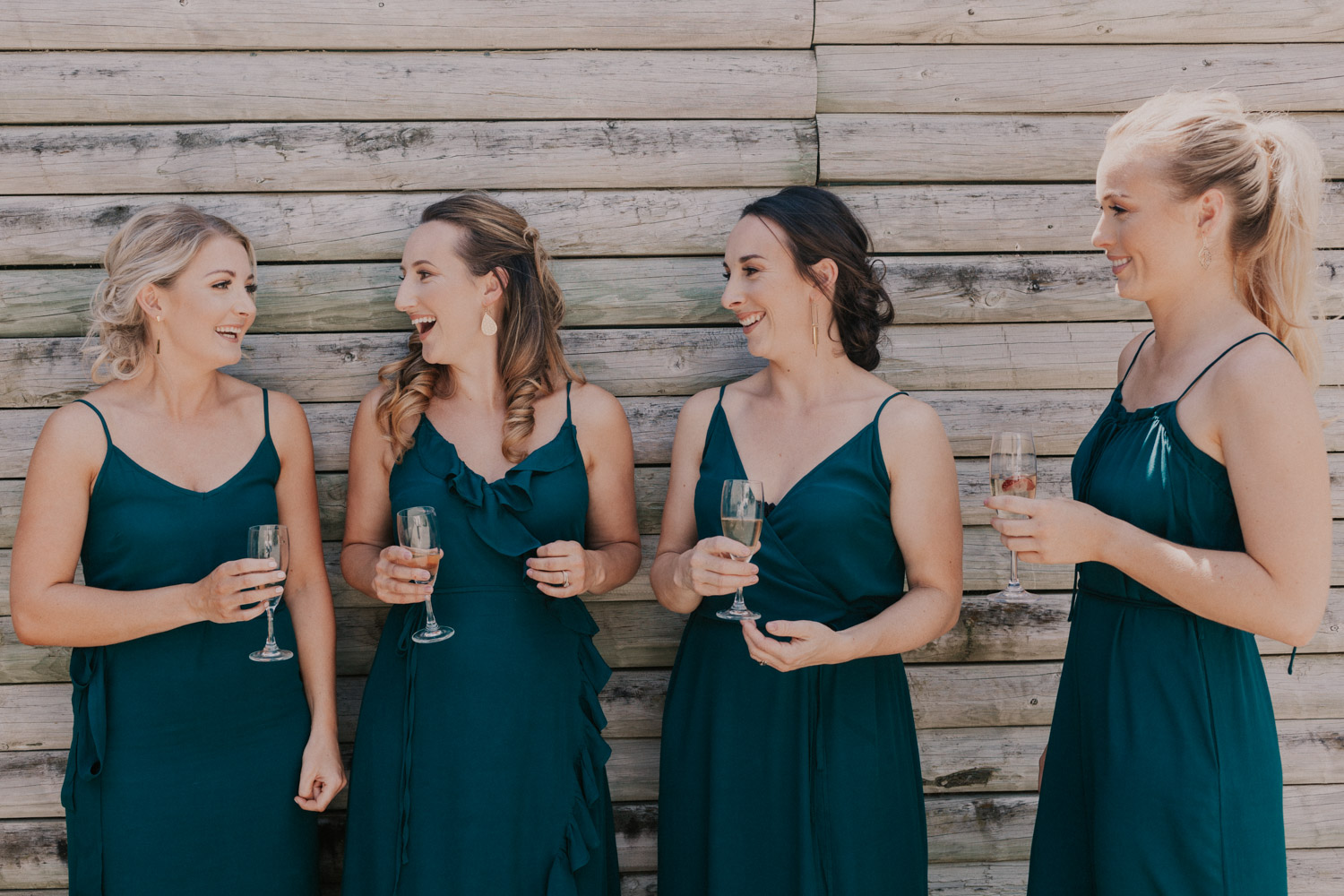 bridesmaids wearing forest green dresses