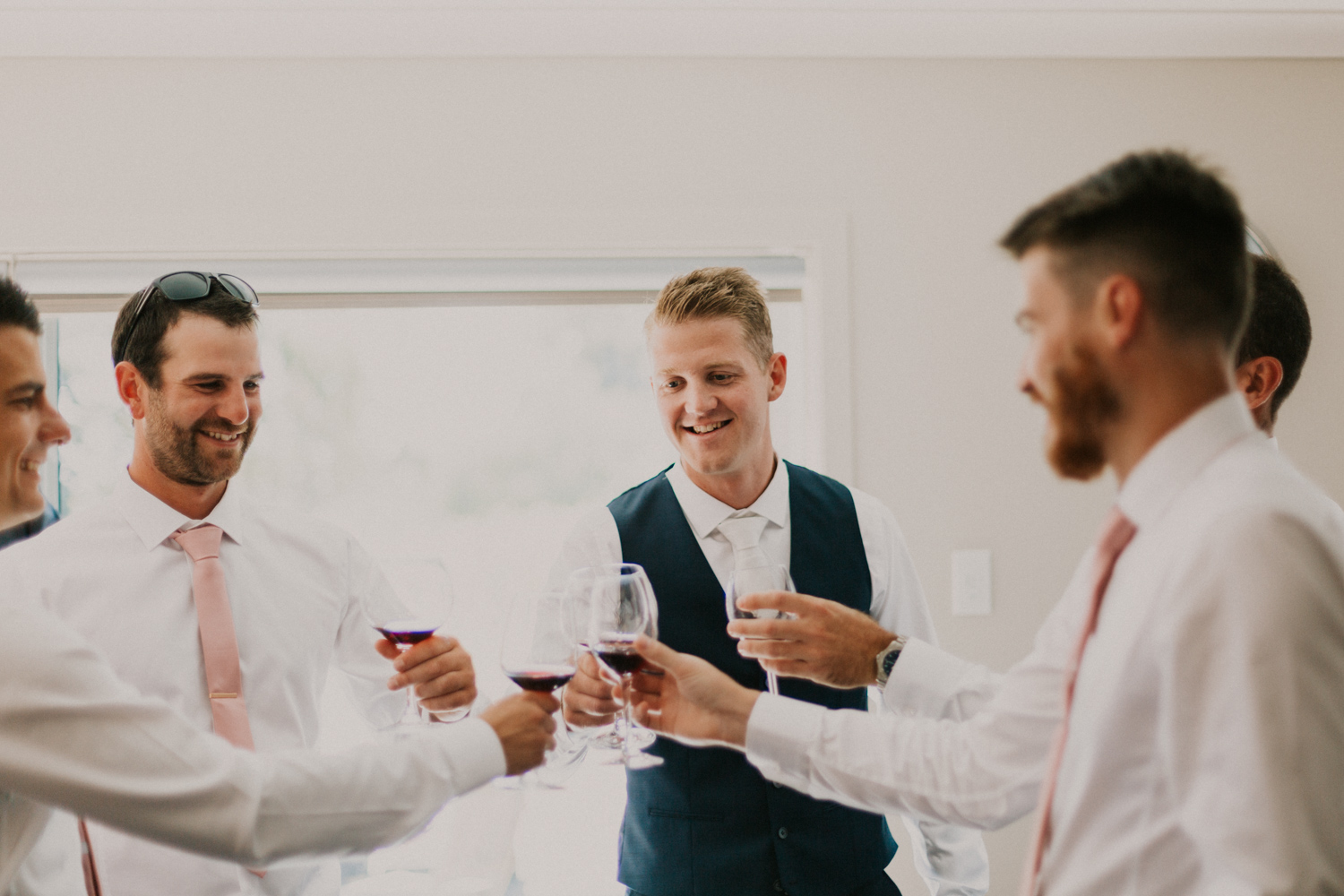 Groom and Groomsmen saying cheers