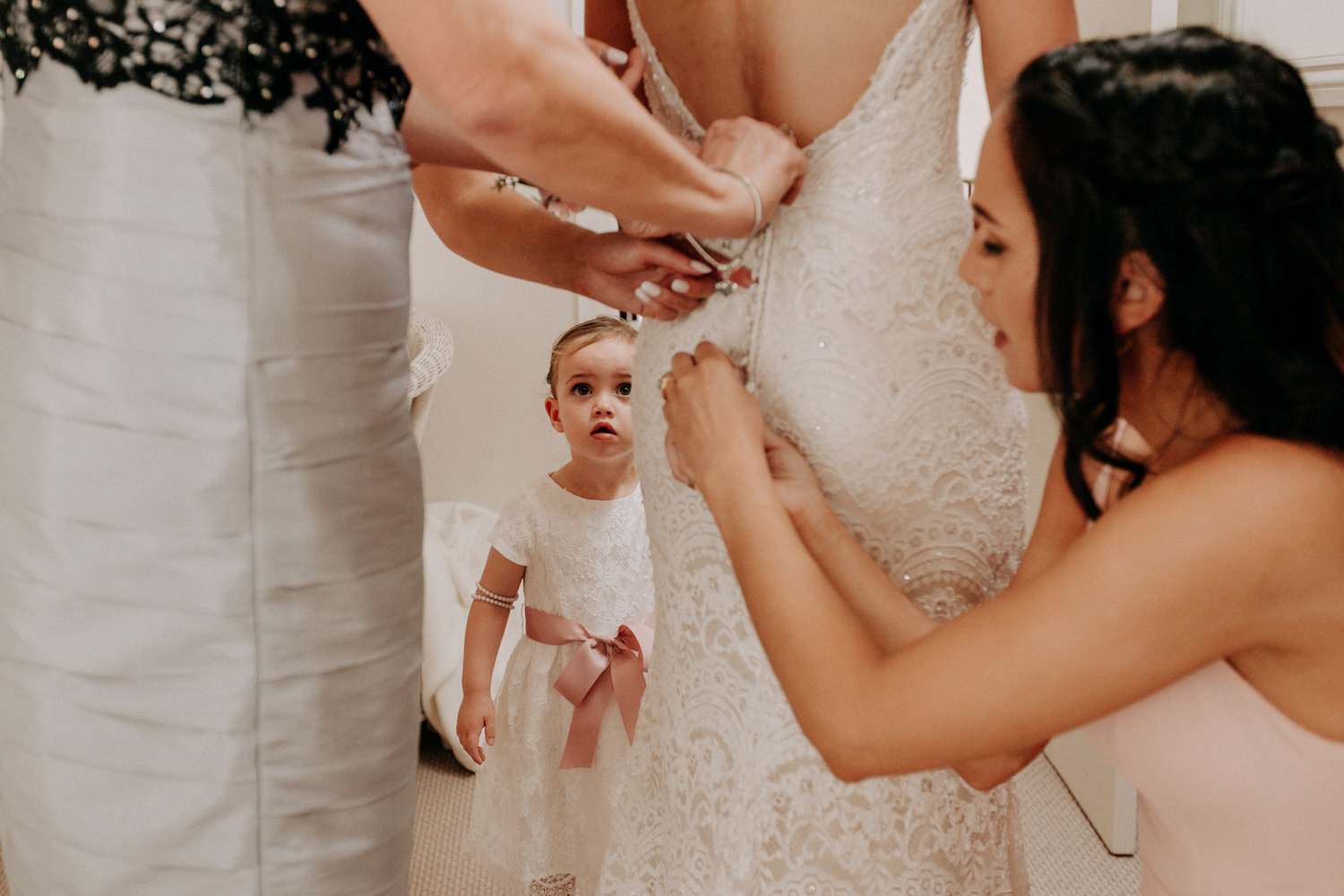 Flower girl getting ready with Mother