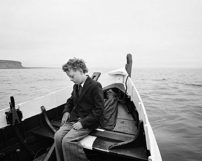 Simon Being Taken out to Sea for the First Time since His Father Drowned, Skinningrove, North Yorkshire , negative 1983; print 2014, Chris Killip, gelatin silver print. Courtesy of and © Chris Killip. Image from the exhibition  Now Then: Chris Killip and the Making of In Flagrante,  May 23-August 13, 2017, Getty Center.
