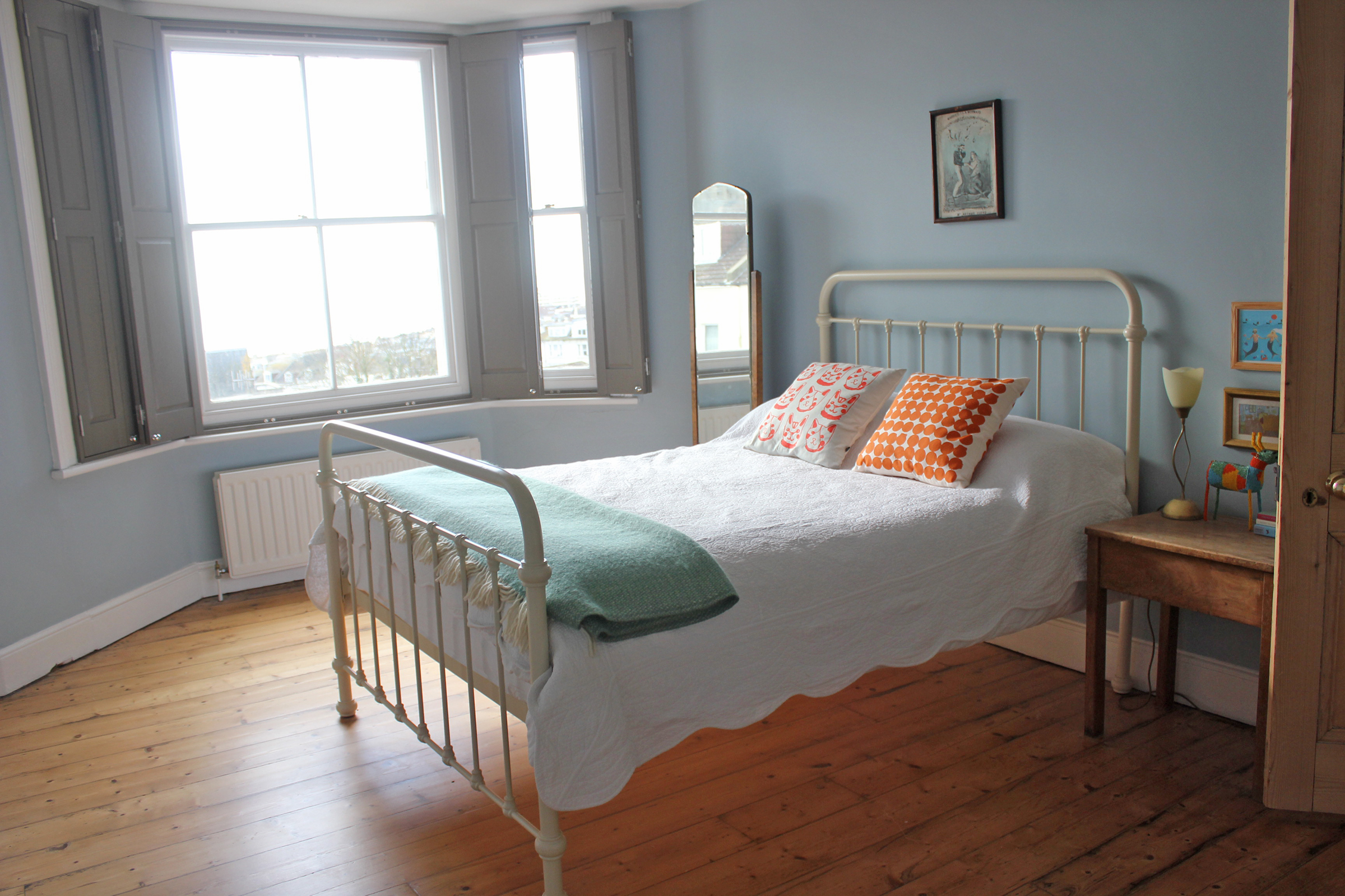 The Blue Bedroom. This room definitely has the best view in the house. Our friends love staying over in this room - it has a great seaside holiday feel. It overlooks the sea and Marine Court (a 1930's building made to look like a ship). The bed is from  Feather & Black  and the walls are painted Parma Gray from Farrow & Ball.