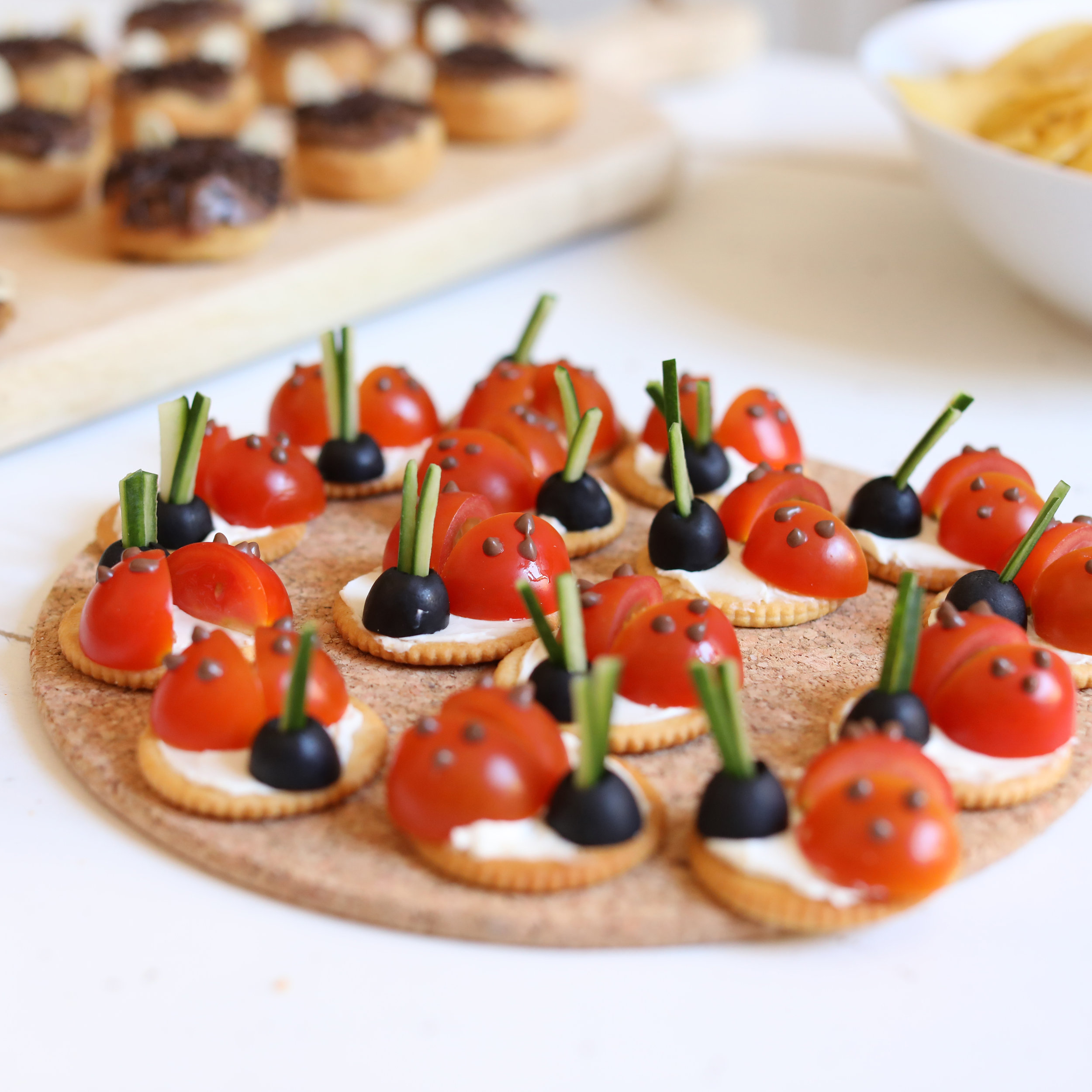 Party Food. Ladybirds made with crackers, Cherry tomatoes, black olives, cream cheese and cucumber. Cheesy mice, cracker spiders, grape forms & biscuit bear claws.
