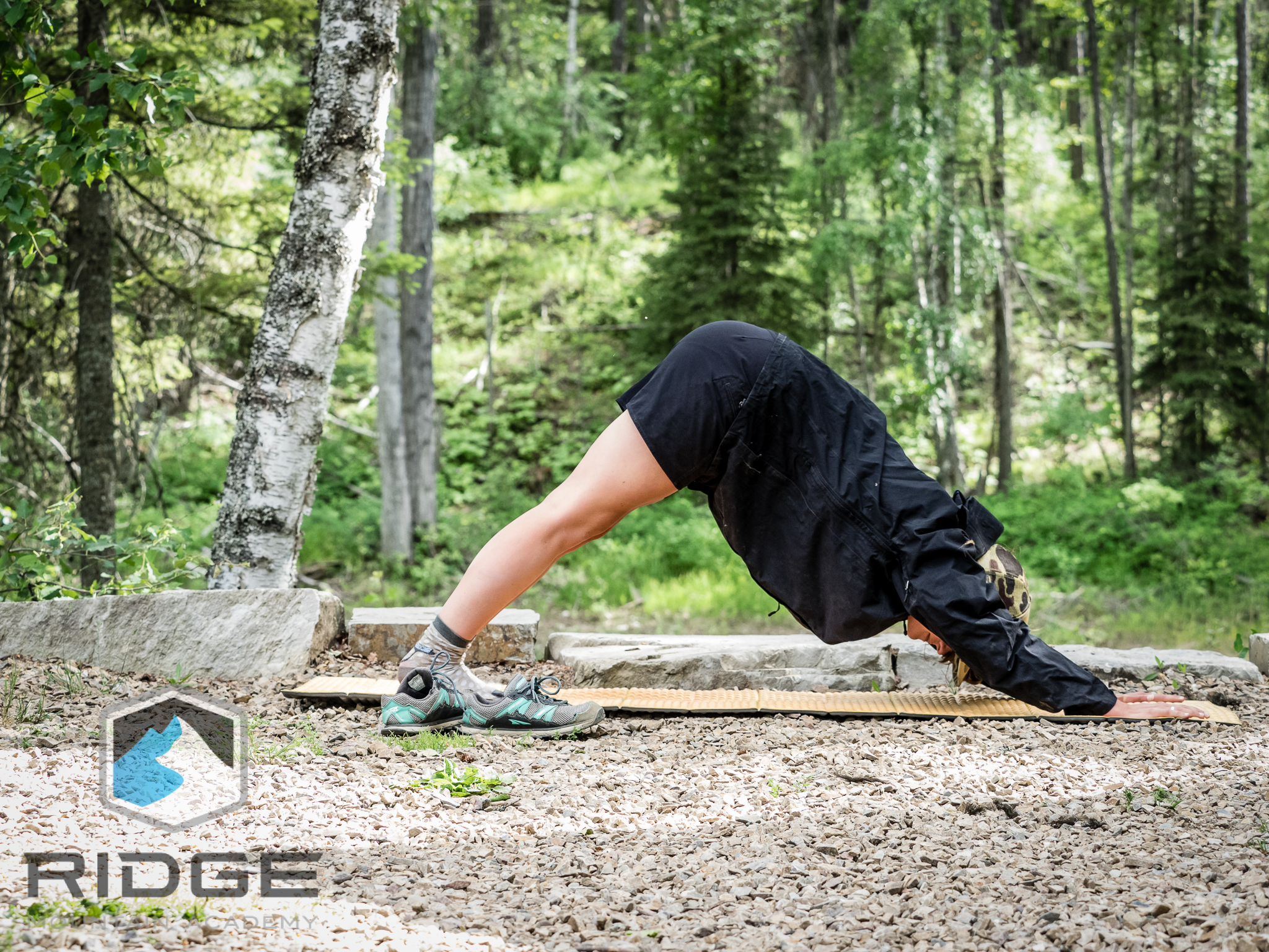 RIDGE Lead Yoga Coach, Cat Jenks, making time for downward Dog in camp.