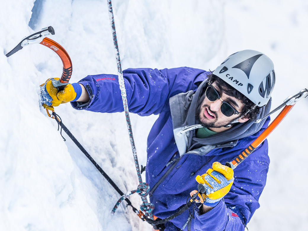 Student athlete ice climbing during a snowboard gap year semester