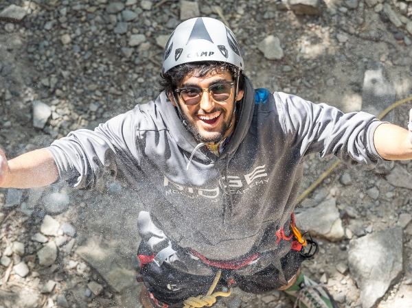 Copy of RIDGE Academy climbing student athlete chalking up before a climb