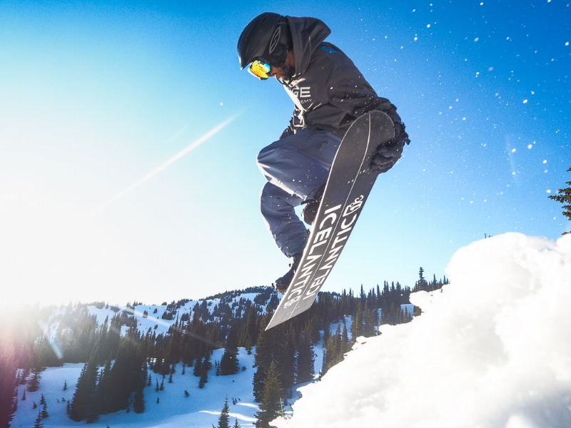 Snowboarder catching air during a RIDGE snowboard Academy semester in Montana