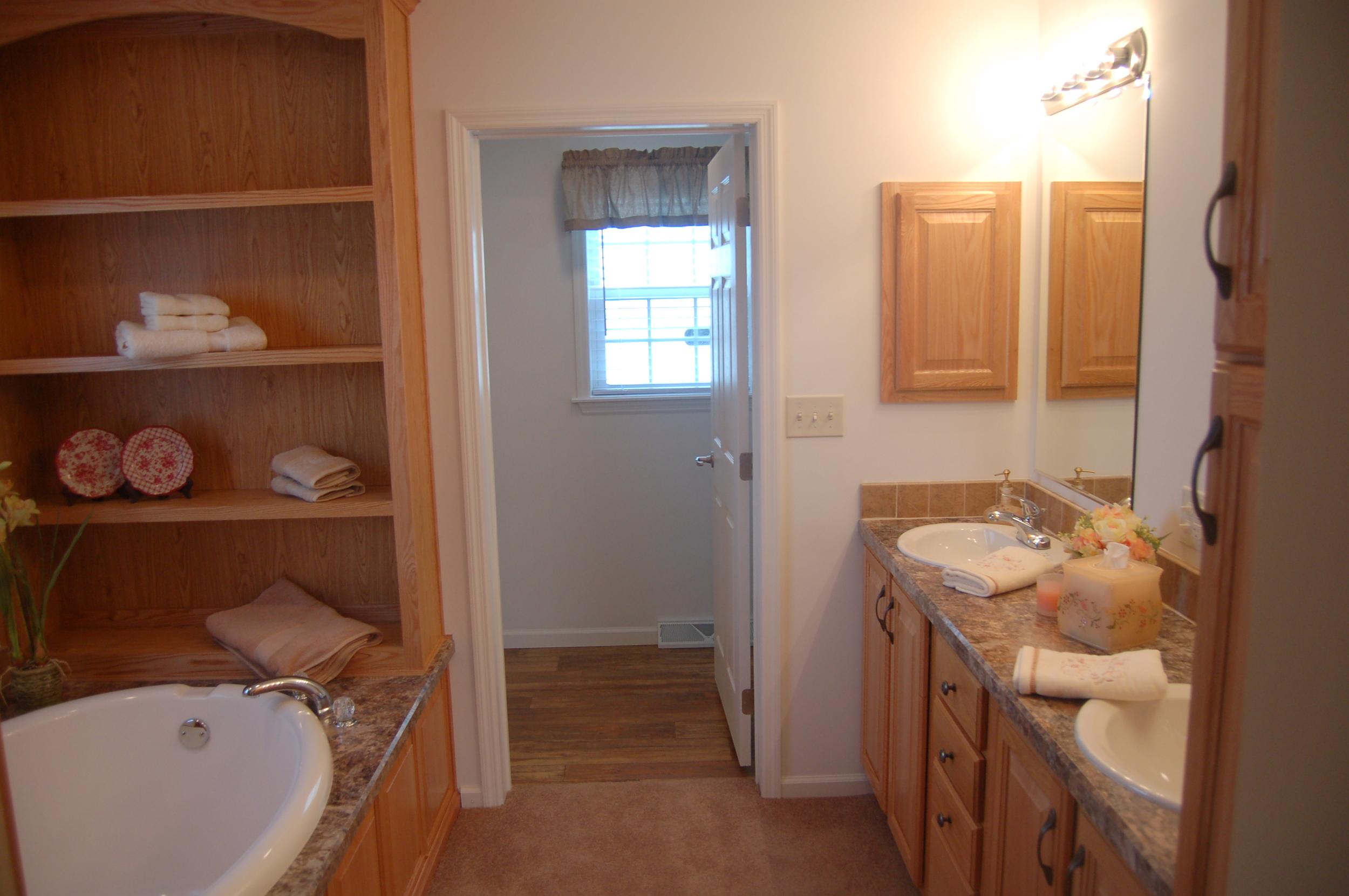 Master Bath Medicine Cabinet, Soaker Tub, and Decorative Shelving (Natural Oak Cabinetry)