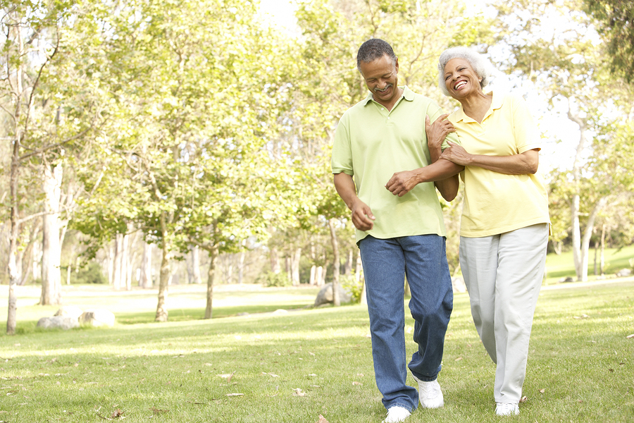 Senior couple walking bigstock-Senior-Couple-Walking-In-Park-13909586.jpg