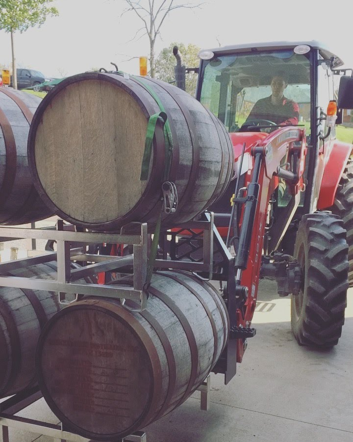 Head Brewer Joey transporting barrels filled with beer
