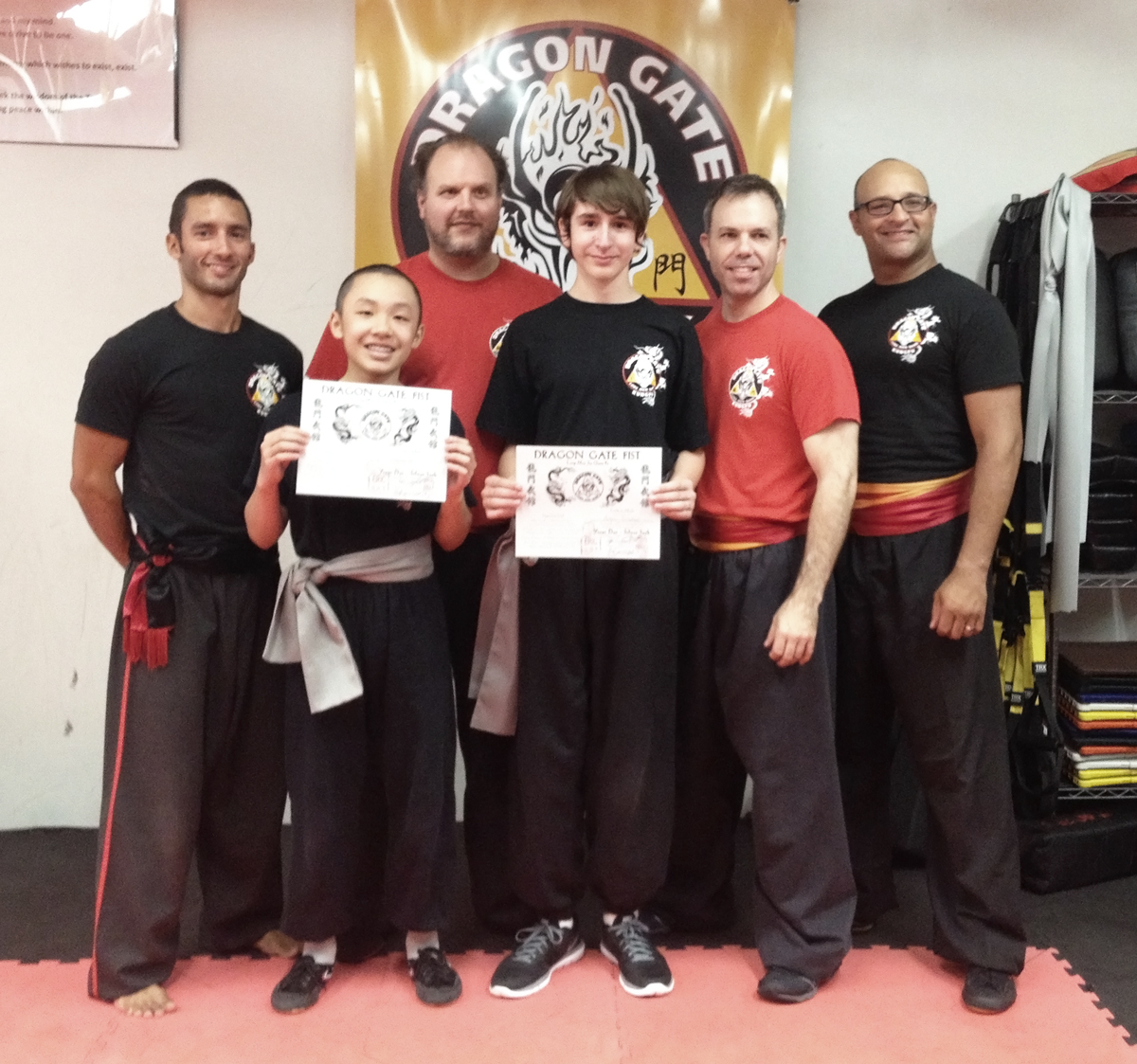 Shissu Eric Matta, Shifu John Bradley, Shifu Eric LEcuyer and Shifu Umar Arrastia stand with our two new Silver Sash students. Andrew Le and Adam Bradley.