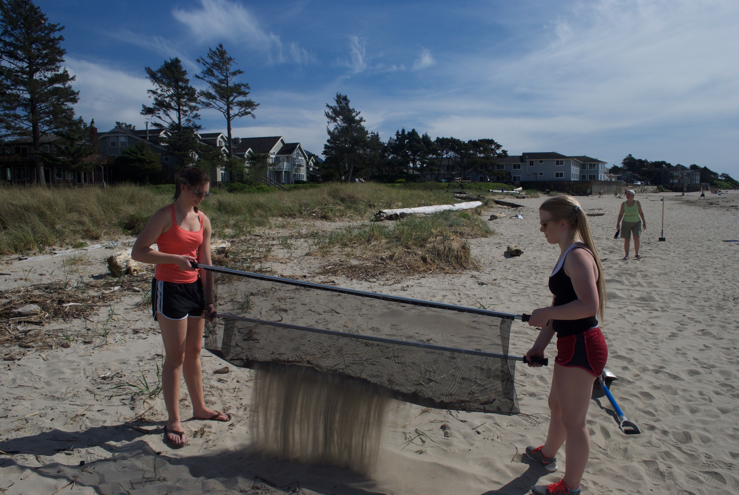 Blue Wave volunteers filter sand at Cannon Beach, Oregon
