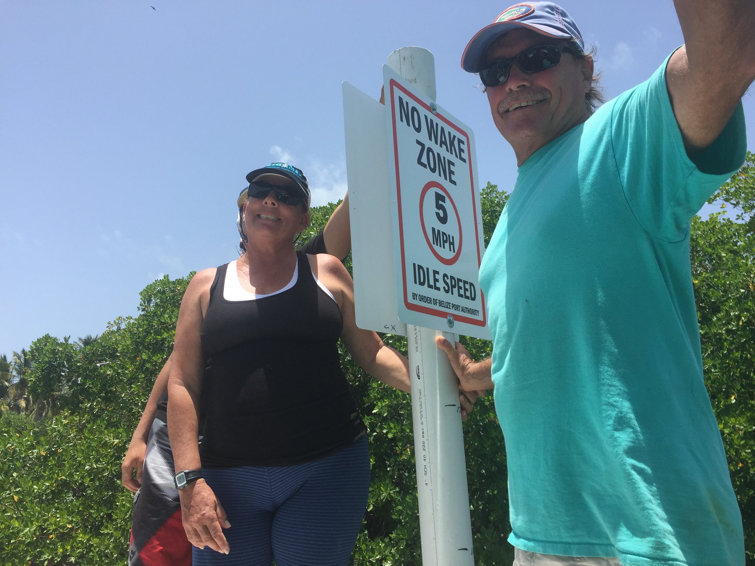 Linda & John Searle of EcoMar with the new speed limit signs that will reduce manatee injuries