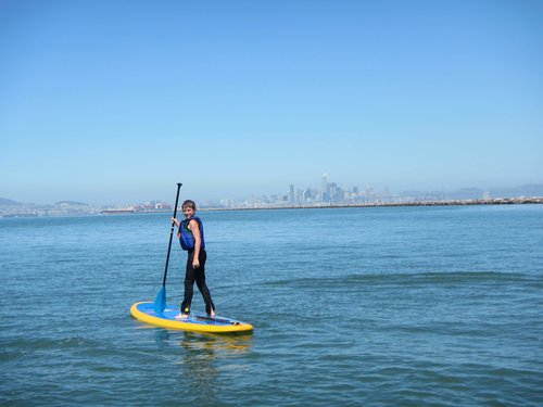 Youth paddler on a board poses