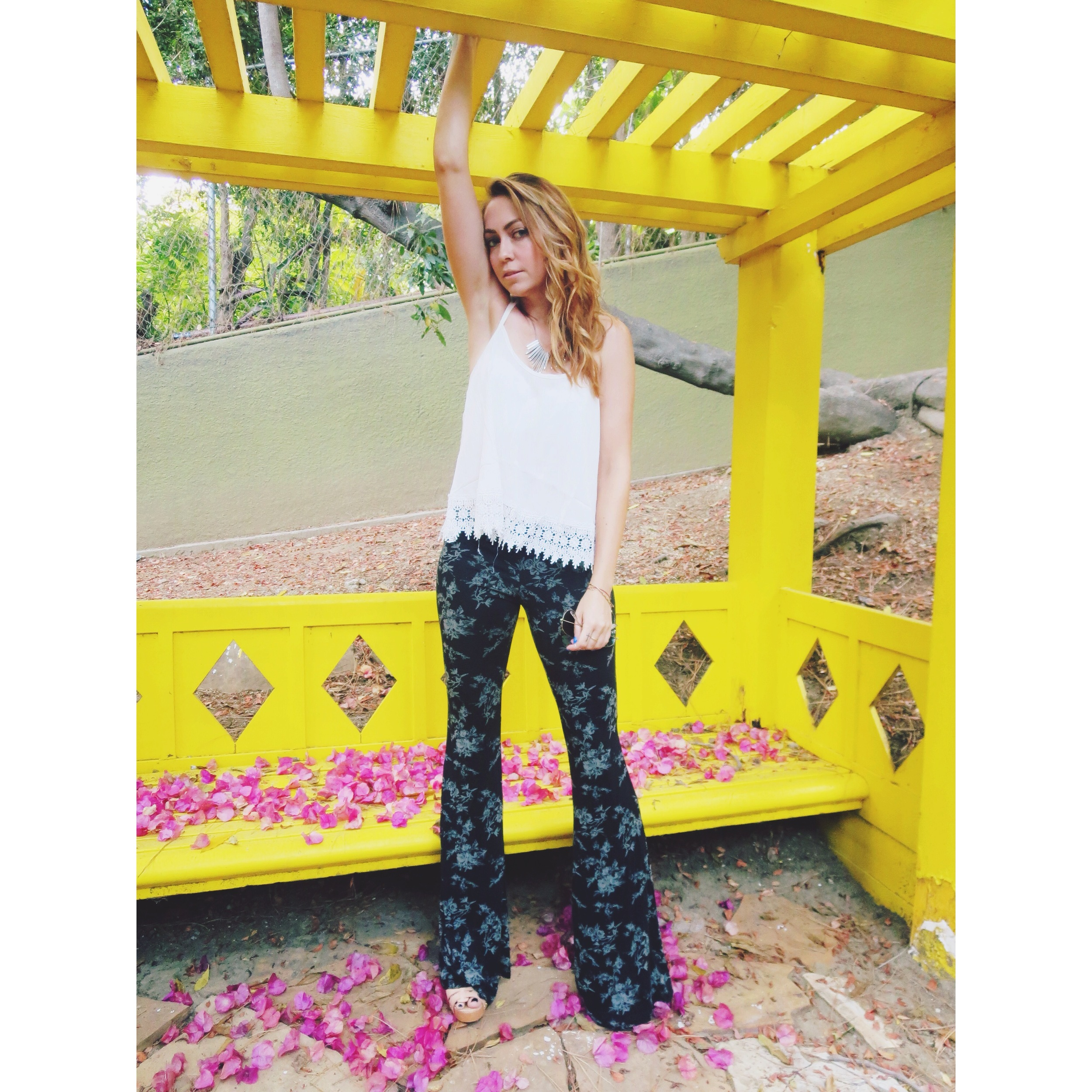 Get This Look :  Crochet Sweet T-Back Shirt ,  Colonia Bell Pants ,  Soda Riane Heels ,  Metal Dagger Spray Necklace
