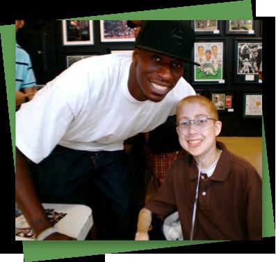 Richie with former Dallas Mavericks basketball player Josh Howard