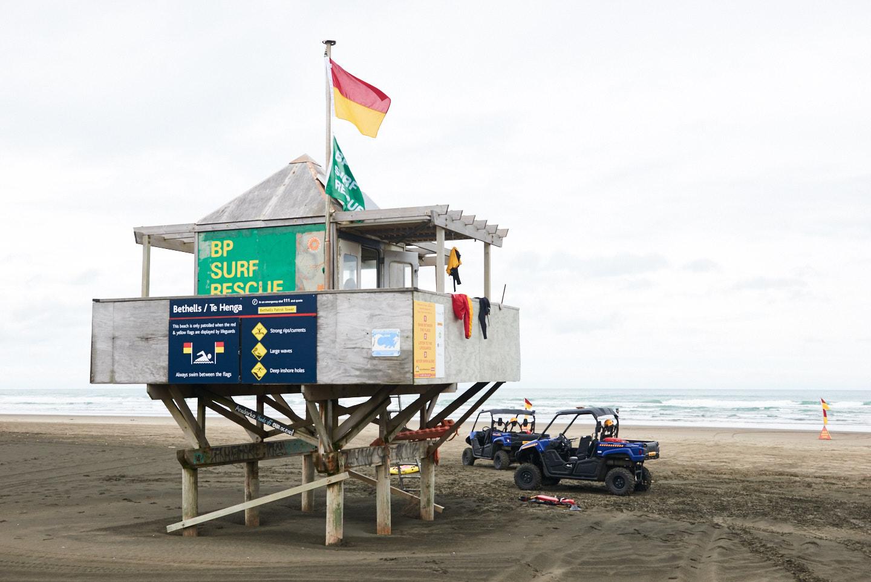 Surf life guards at Bethells Beach