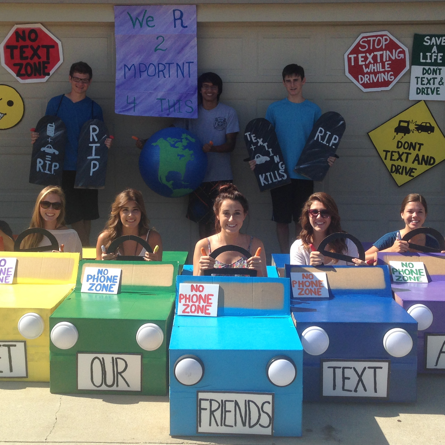 Kendra - -We actually made the cars out of cardboard boxes and used the left over cardboard to make the signs hanging in the background. We even painted one of our exercise balls to look like the word. I am very lucky to have the friends i .jpg