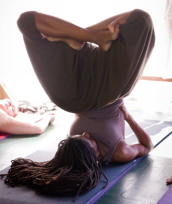 Jah9 rocking some yoga moves in her dropbottoms