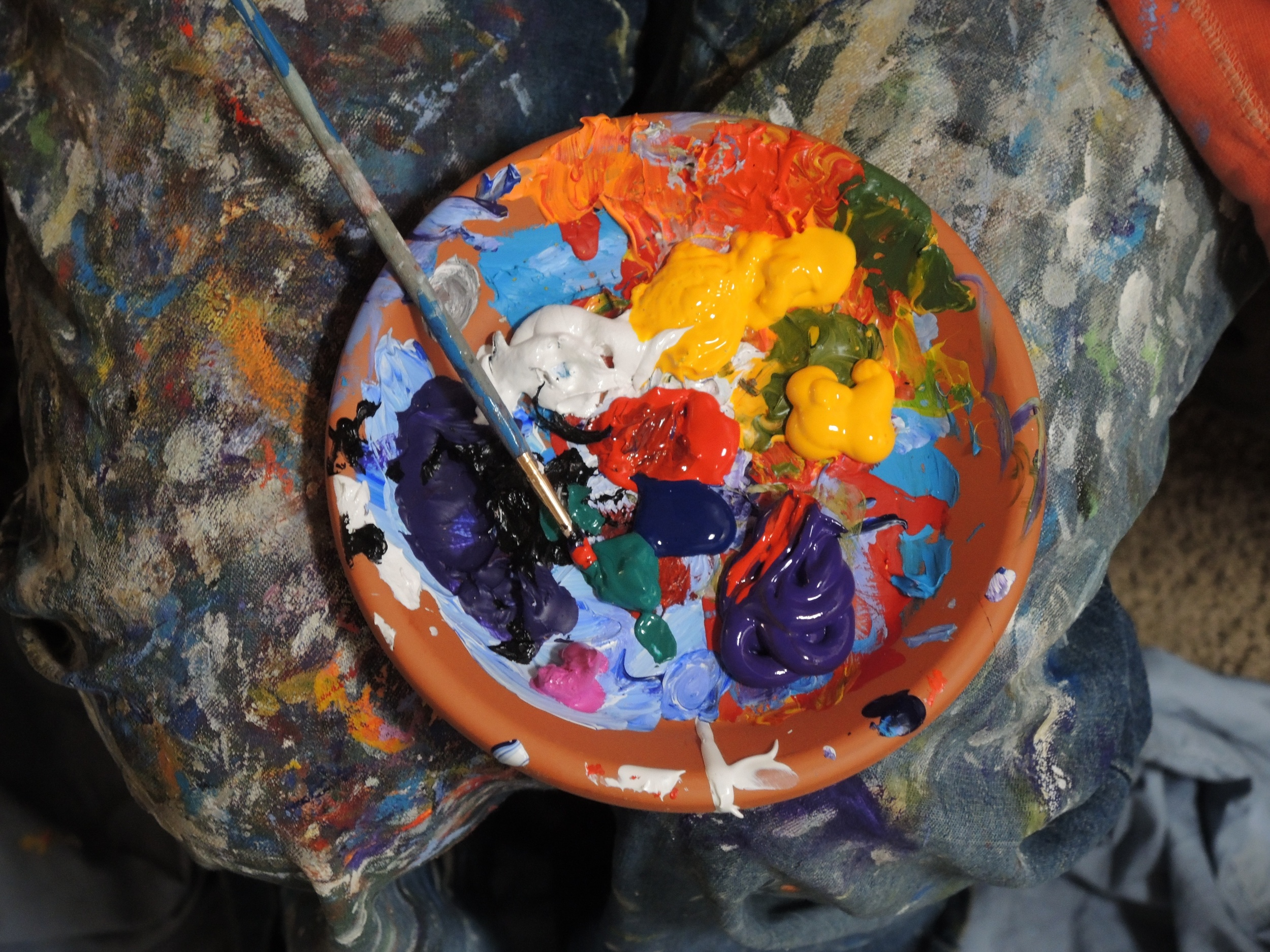 An artist's palette with various paint colors.