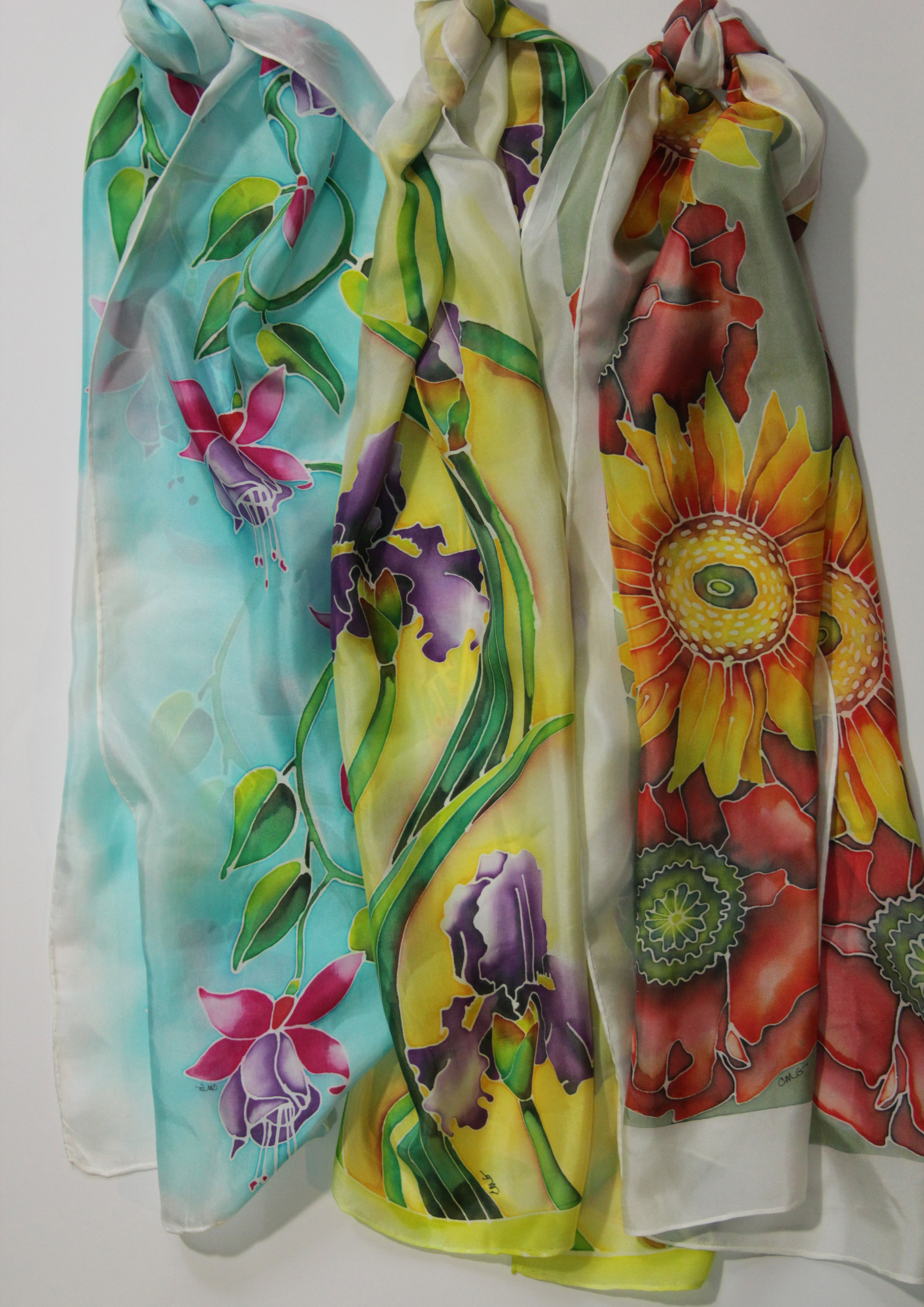 The three scarves shown together