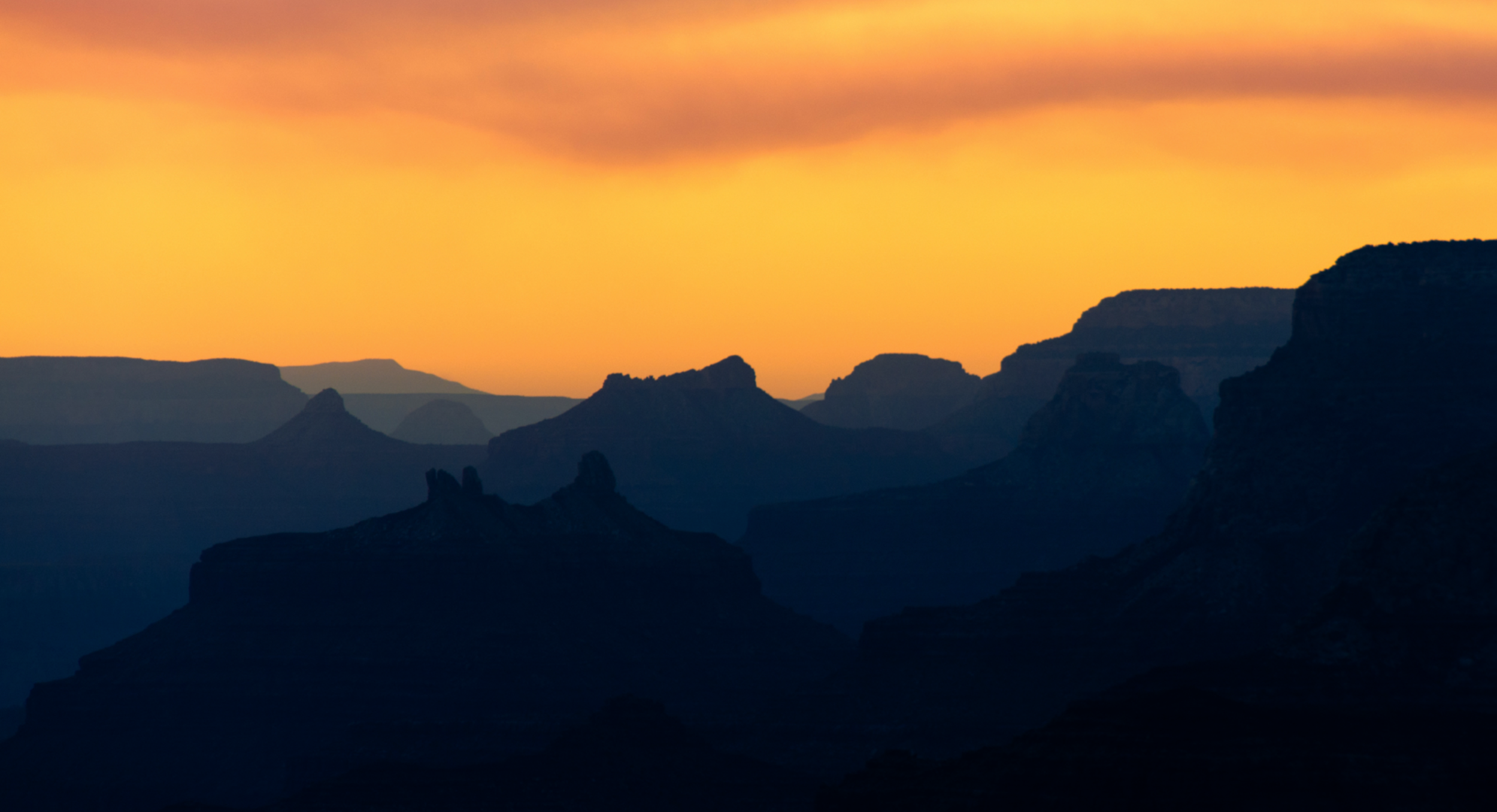 IV. Sunset   Animal calls herald the close of the day, as the sun slowly sinks behind the formations of the canyon. Finally the stars emerge.