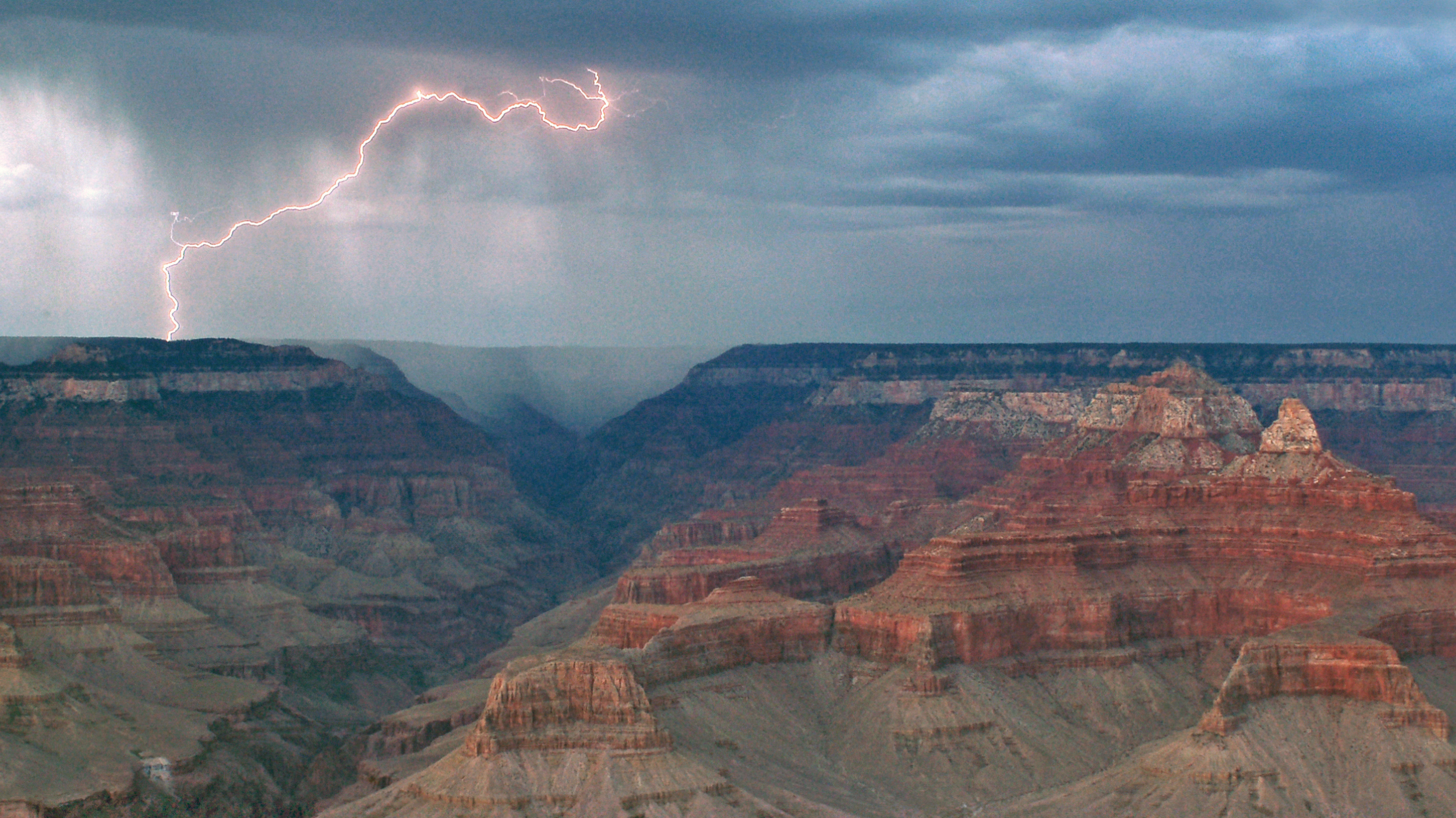 V. Cloudburst   Beginning with magical glimpses of a snow-covered canyon in winter, this movement moves into a dark and violent storm. Once the storm passes, the canyon is revealed in its full grandeur.